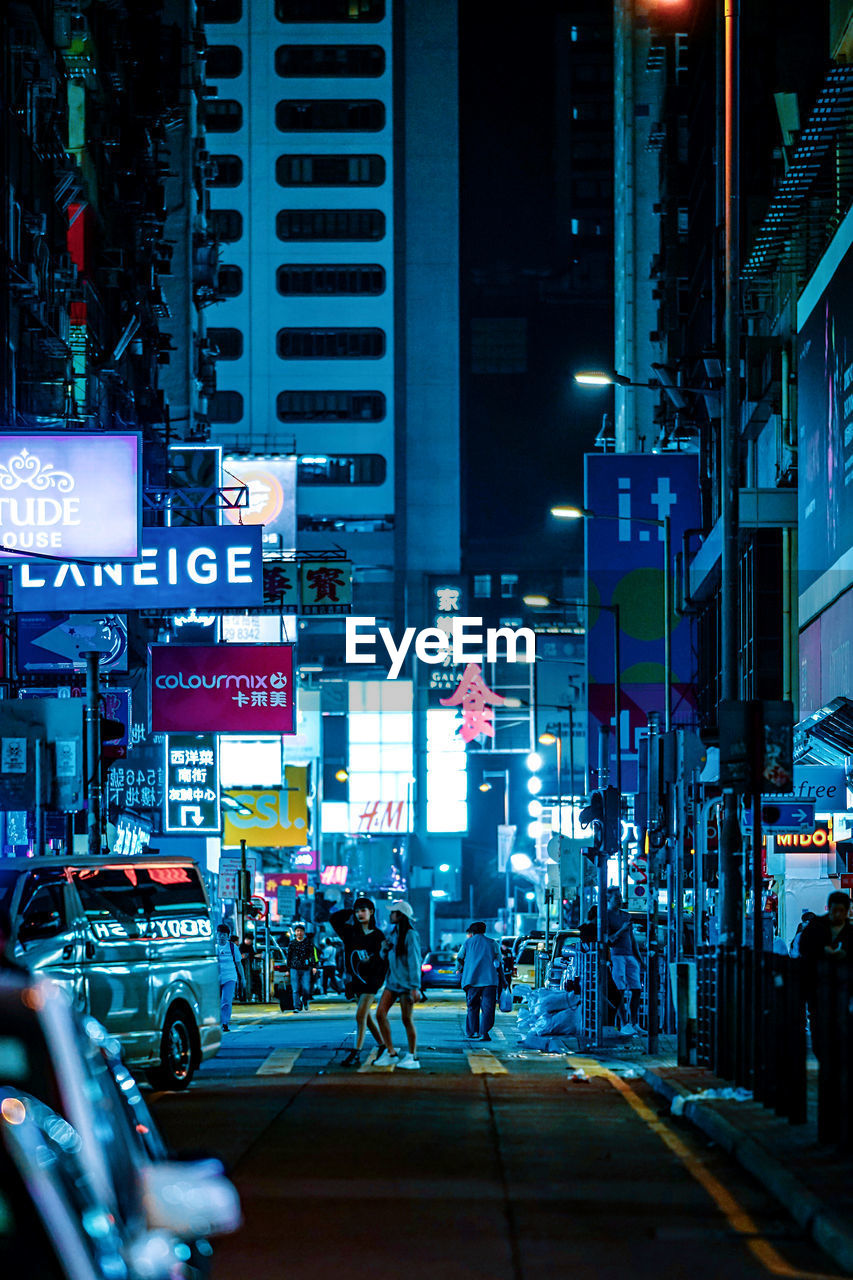 city, architecture, street, building exterior, built structure, city life, illuminated, night, sign, transportation, road, communication, group of people, motor vehicle, city street, commercial sign, advertisement, mode of transportation, car, crowd, outdoors, office building exterior, neon, skyscraper