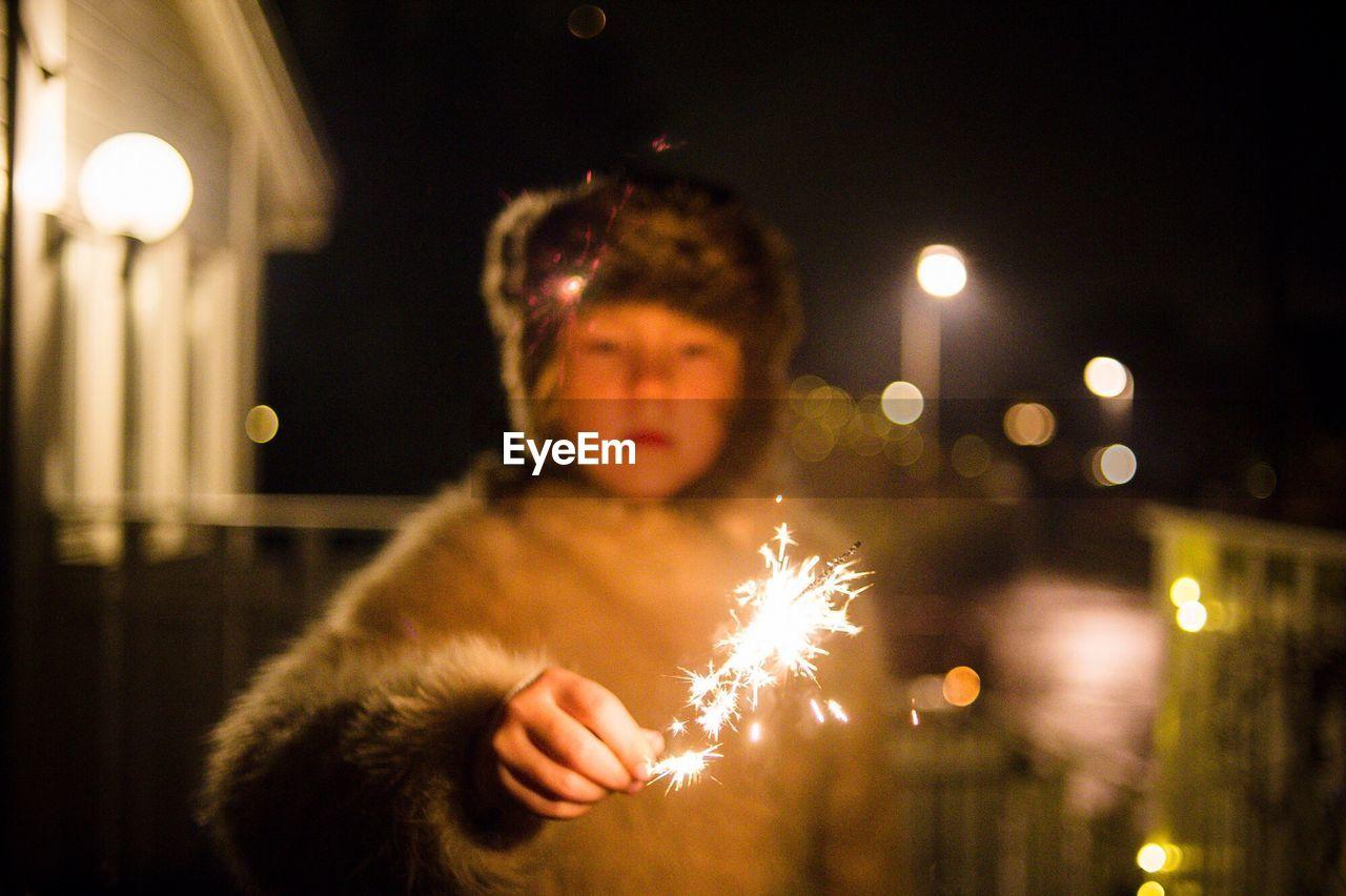 Portrait Of A Child Holding Sparkler