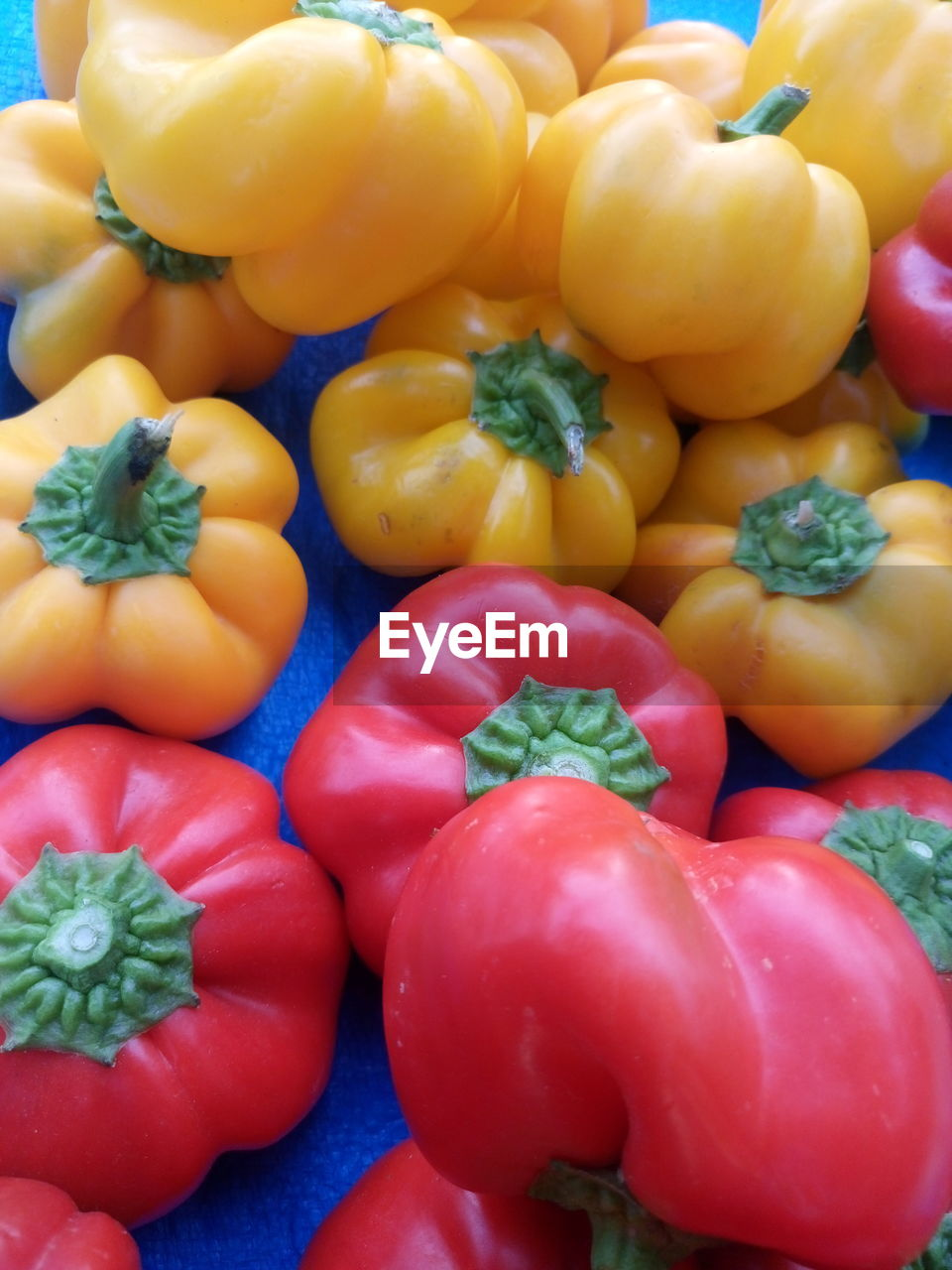 High Angle View Of Bell Peppers At Market For Sale