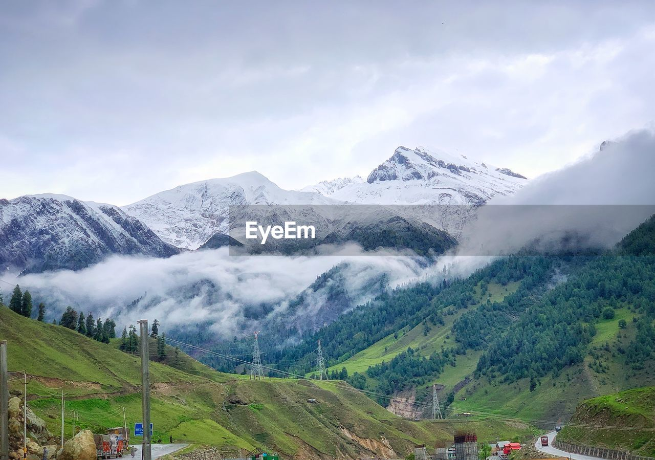 mountain, scenics - nature, beauty in nature, sky, environment, mountain range, landscape, tranquil scene, cloud - sky, non-urban scene, tranquility, cold temperature, snow, winter, nature, idyllic, snowcapped mountain, no people, plant, outdoors, mountain peak, range