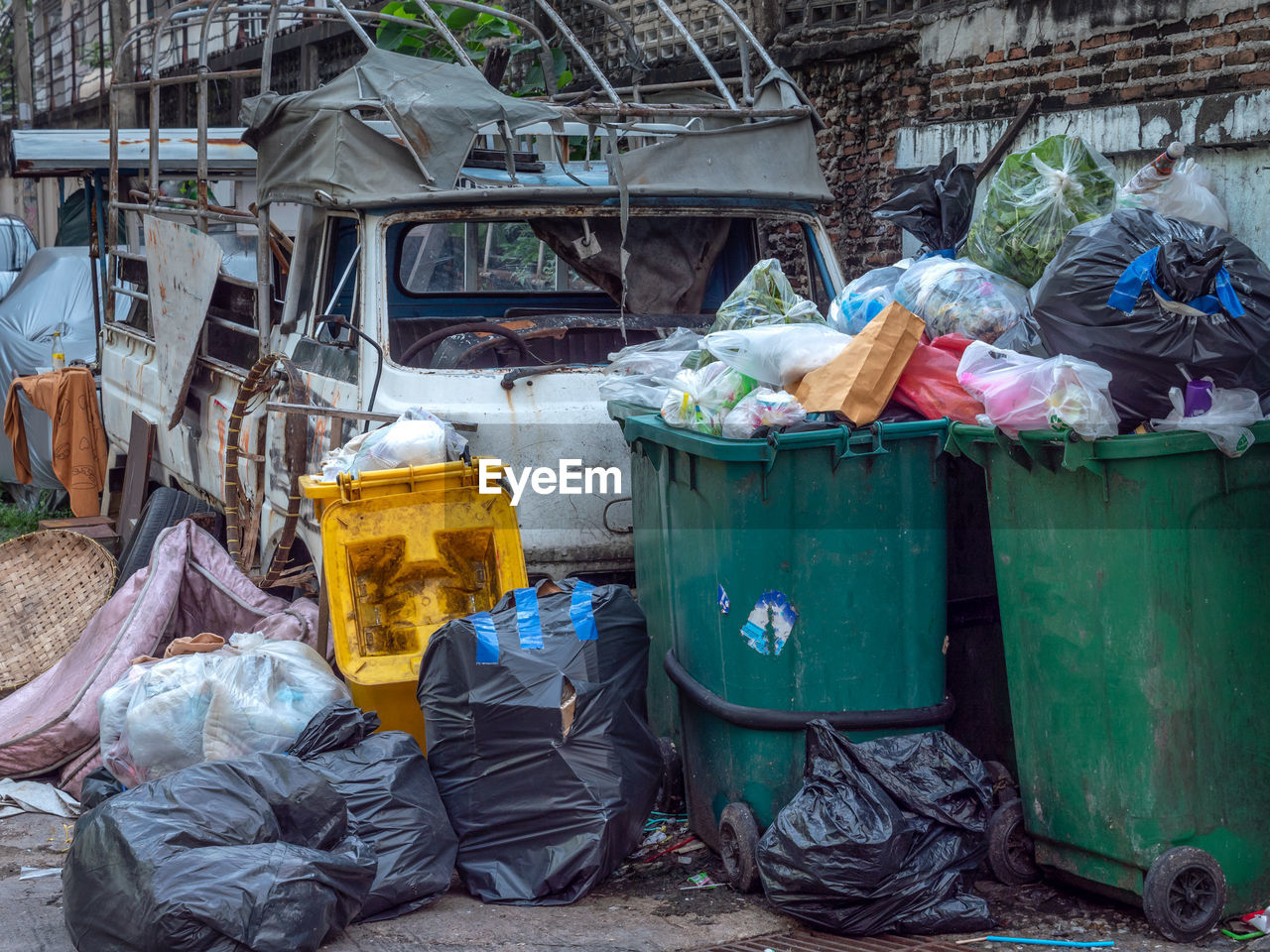 garbage, environmental issues, plastic, pollution, garbage bin, recycling, garbage dump, day, environment, unhygienic, container, large group of objects, dirty, messy, plastic bag, bag, garbage bag, dirt, architecture, nature, outdoors