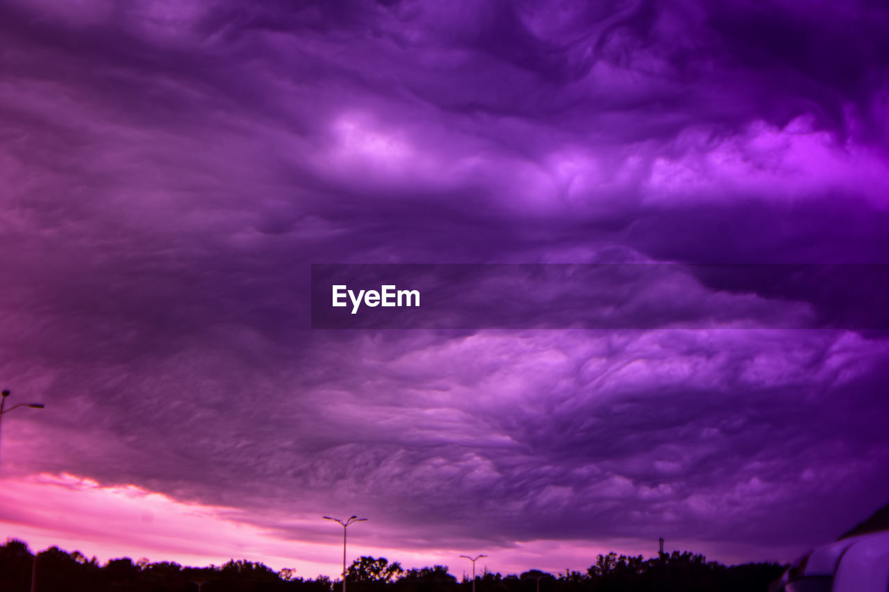 cloud - sky, sky, beauty in nature, dramatic sky, no people, purple, scenics - nature, sunset, tranquility, low angle view, tranquil scene, nature, overcast, storm, outdoors, silhouette, dusk, storm cloud, idyllic, ominous, power in nature