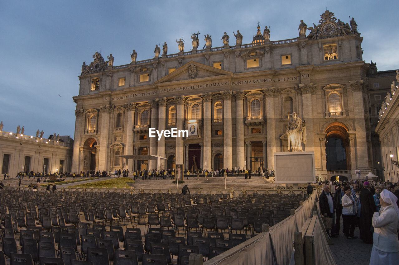 Seats Arranged In Front Of St Peters Basilica In City At Dusk