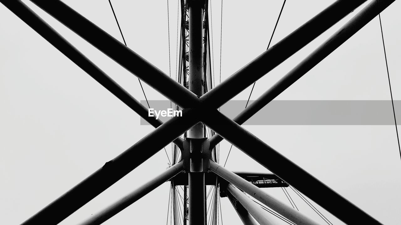 low angle view, sky, architecture, built structure, metal, no people, connection, nature, day, clear sky, bridge, bridge - man made structure, outdoors, transportation, close-up, tall - high, shape, pattern, design, steel, directly below, alloy