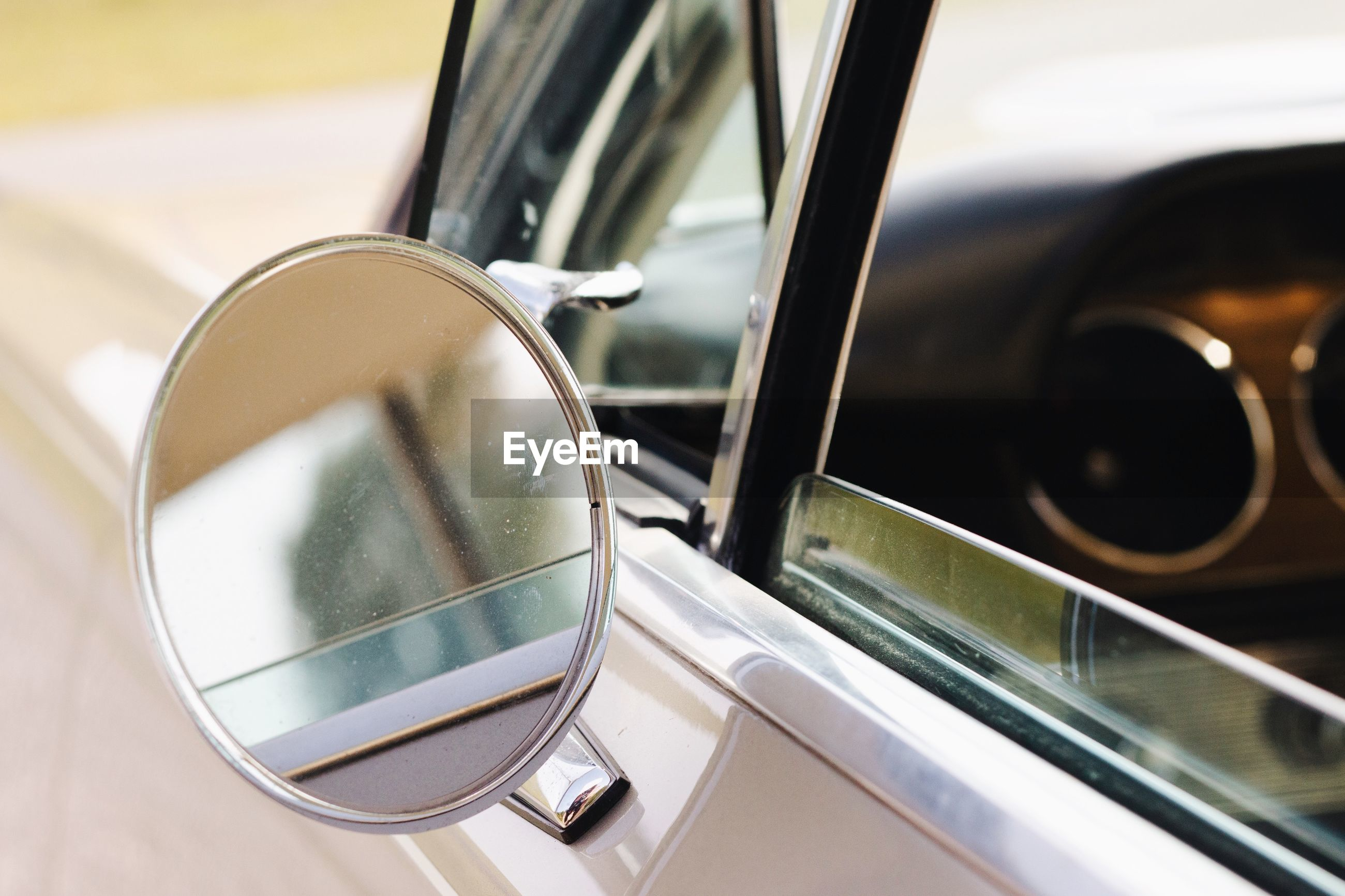 Close-up of side-view mirror of car