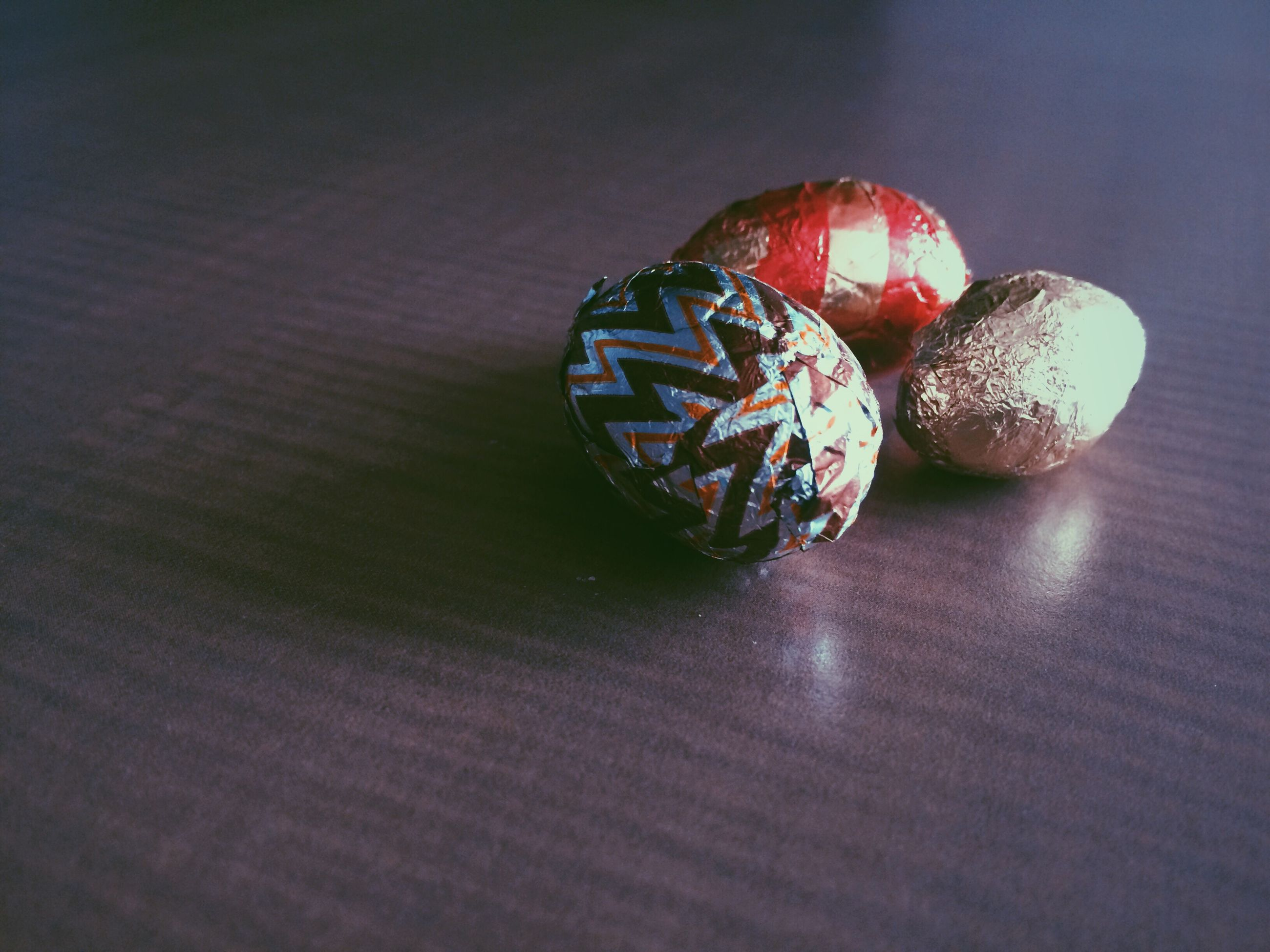 Close-up of wrapped easter eggs on table