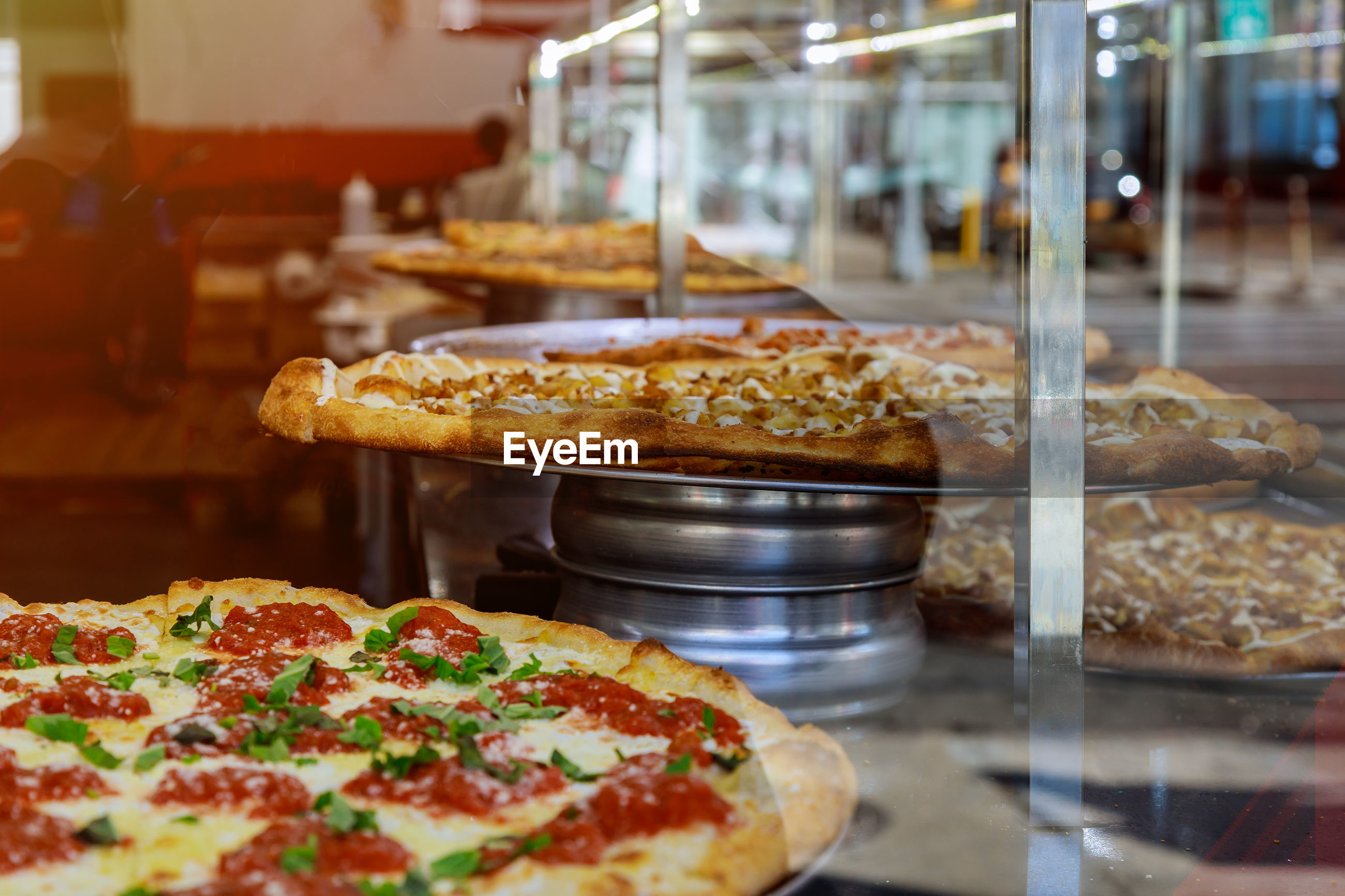 Close-up of pizza in kitchen at restaurant