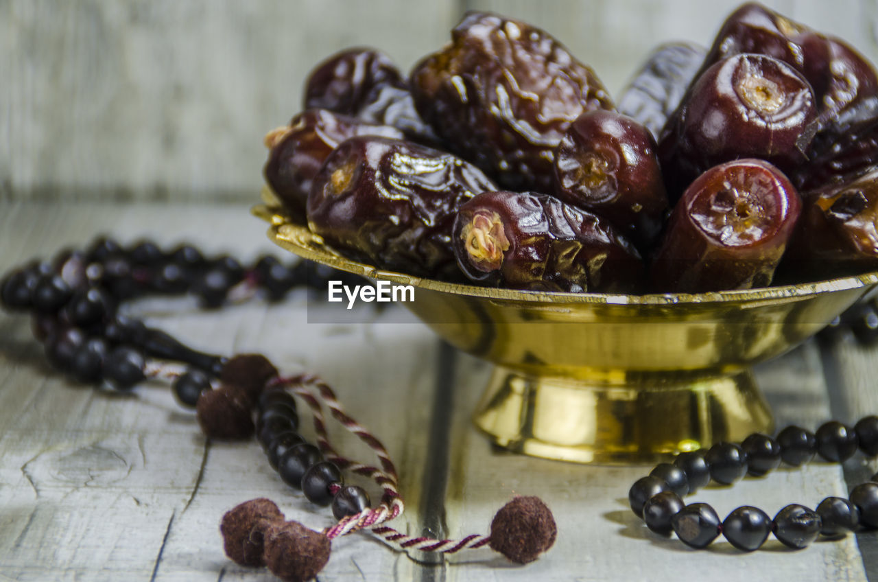 still life, food and drink, food, no people, close-up, indoors, table, fruit, wellbeing, healthy eating, large group of objects, freshness, focus on foreground, bowl, container, bead, high angle view, jewelry, pearl jewelry, roasted coffee bean