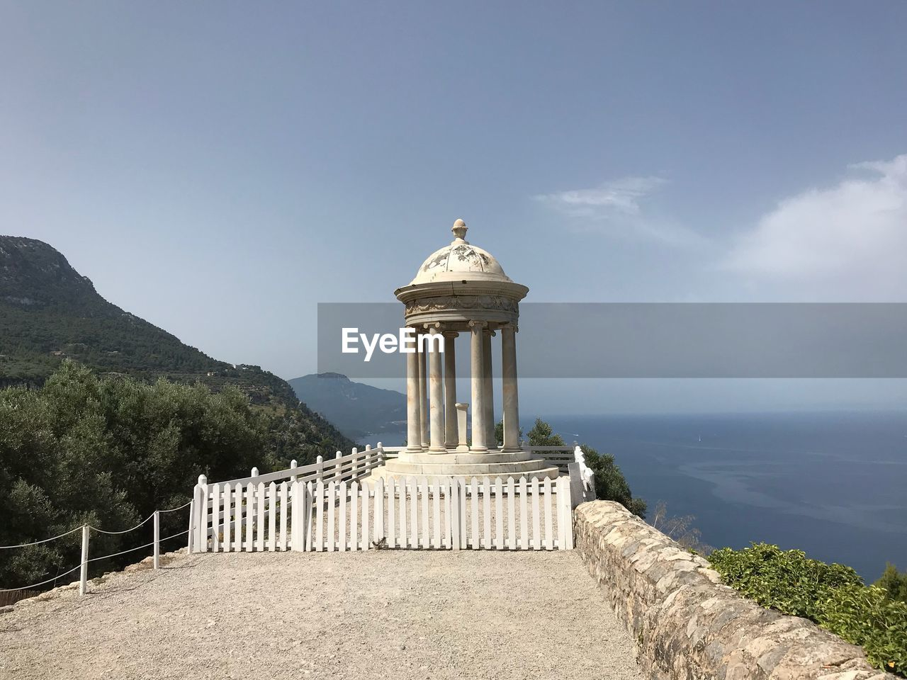 sky, architecture, built structure, nature, travel destinations, day, the past, building exterior, history, scenics - nature, sea, mountain, no people, beauty in nature, architectural column, water, tourism, guidance, direction, tranquility, lighthouse, outdoors