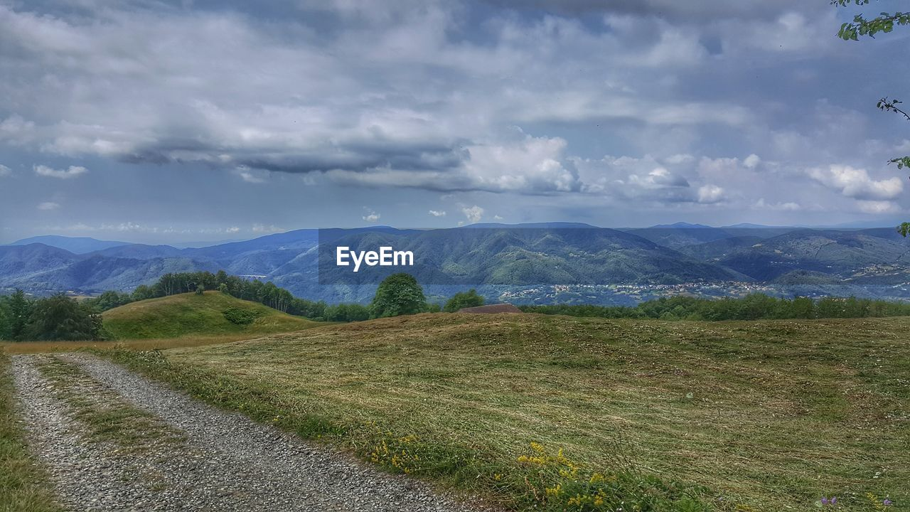 scenics - nature, cloud - sky, sky, mountain, tranquil scene, beauty in nature, environment, tranquility, landscape, plant, mountain range, non-urban scene, nature, no people, idyllic, grass, remote, day, land, green color, outdoors