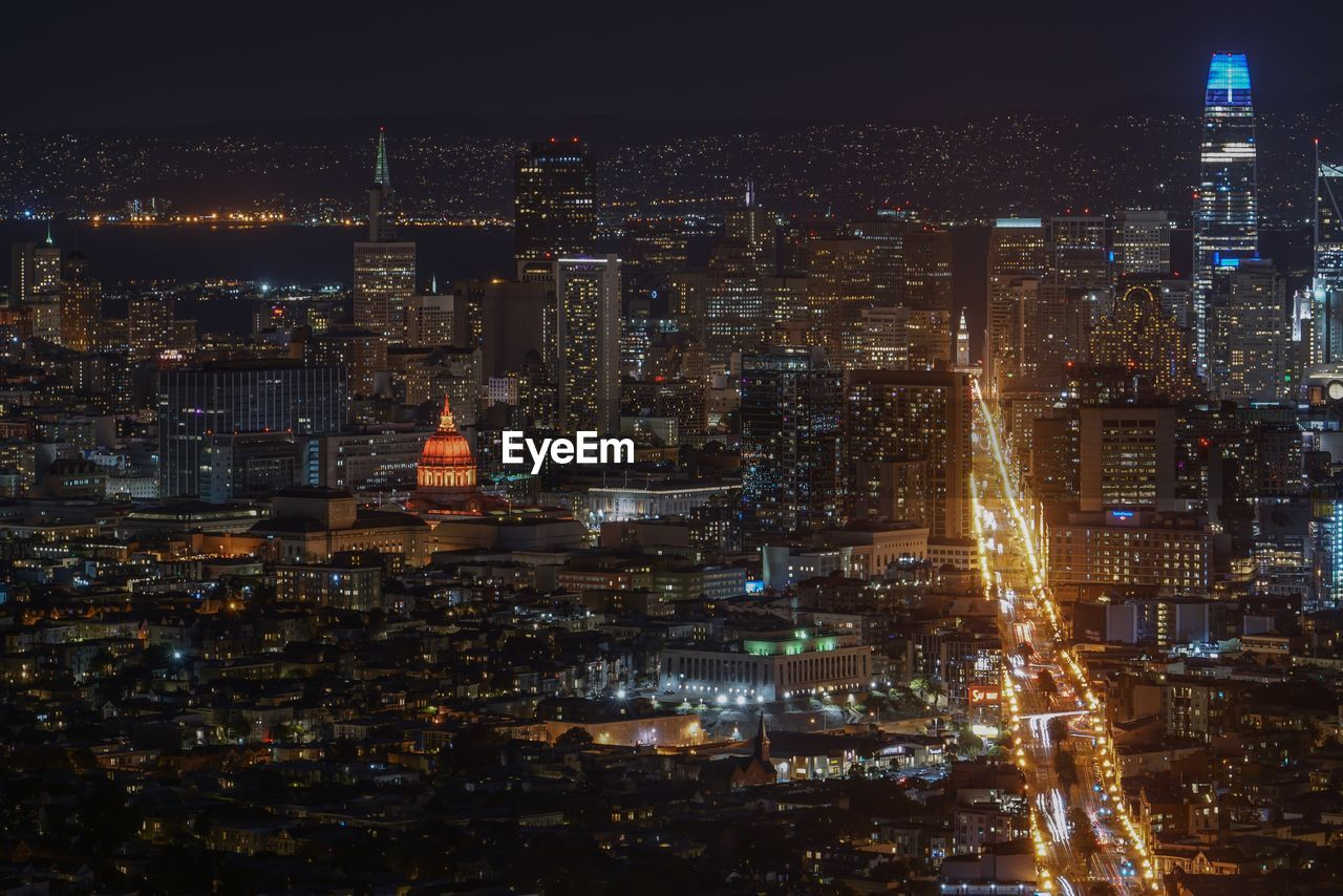 night, building exterior, city, cityscape, illuminated, architecture, built structure, crowd, building, crowded, residential district, high angle view, city life, outdoors, modern, office building exterior, aerial view, glowing, skyscraper, light, nightlife, apartment