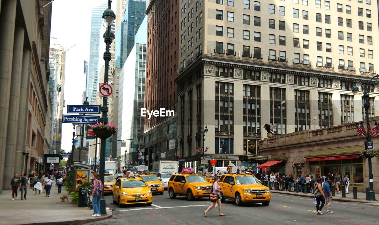 Vehicles on city street alongside buildings