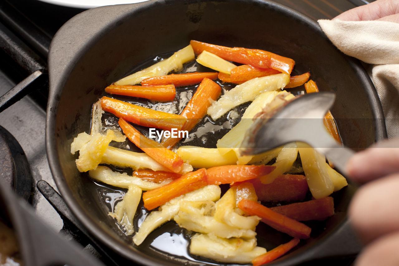 Fresh Carrot And Parsnip Batons In Metal Skillet