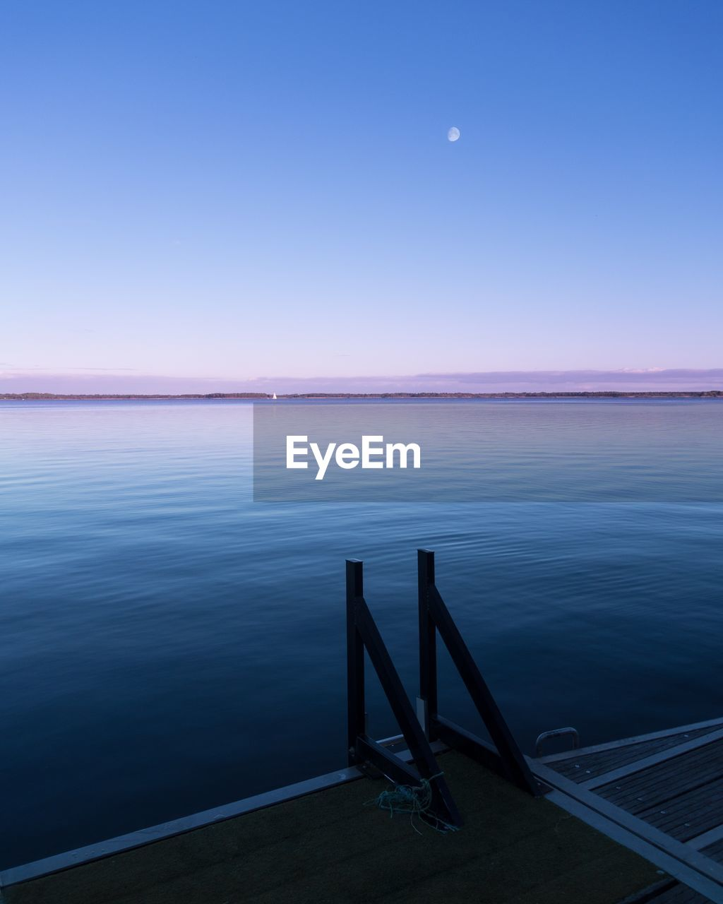 Scenic View Of Sea Against Clear Sky At Night