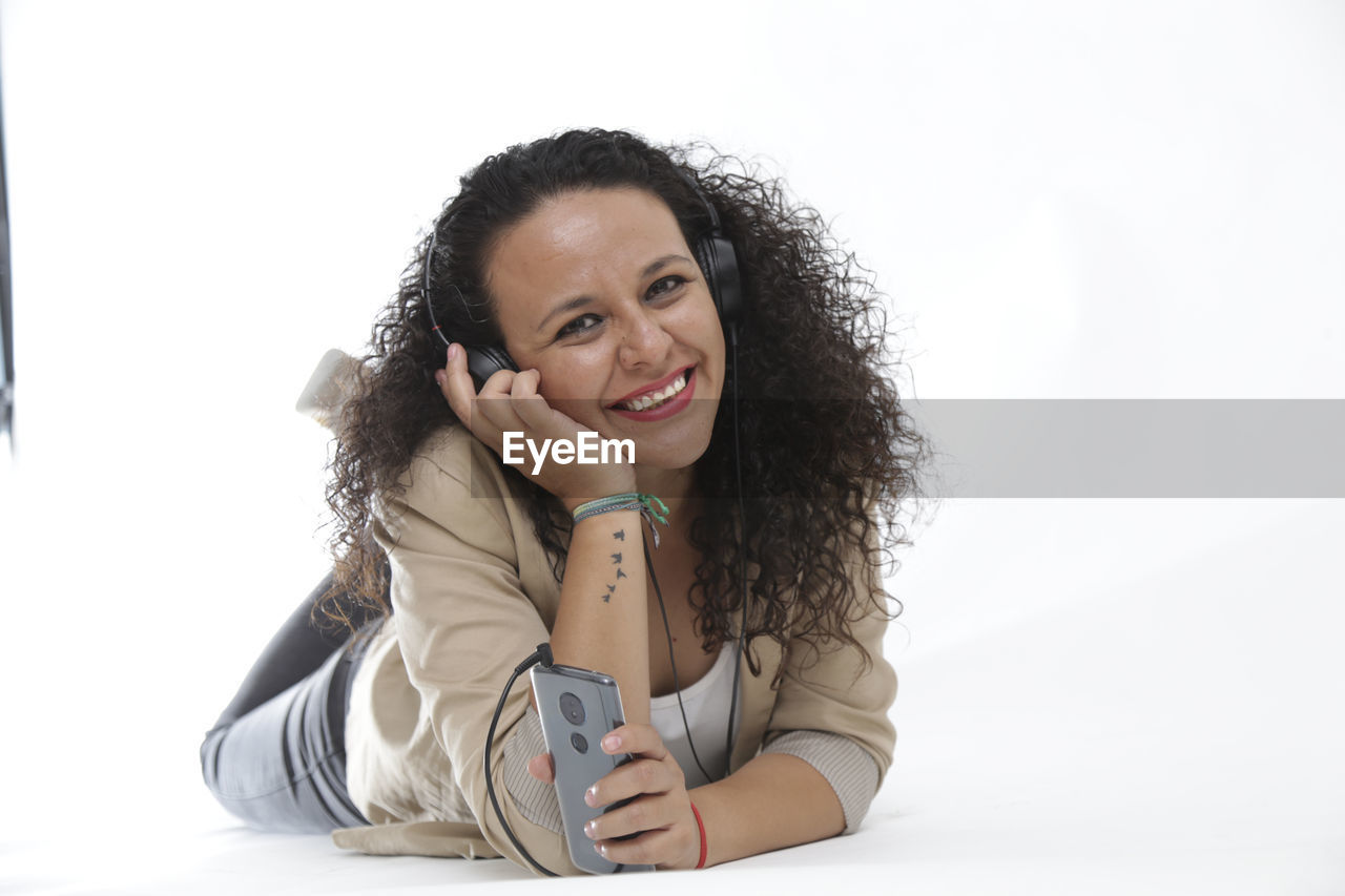 smiling, white background, one person, happiness, portrait, looking at camera, front view, studio shot, hair, indoors, emotion, teeth, hairstyle, toothy smile, curly hair, cut out, women, copy space, long hair, beautiful woman