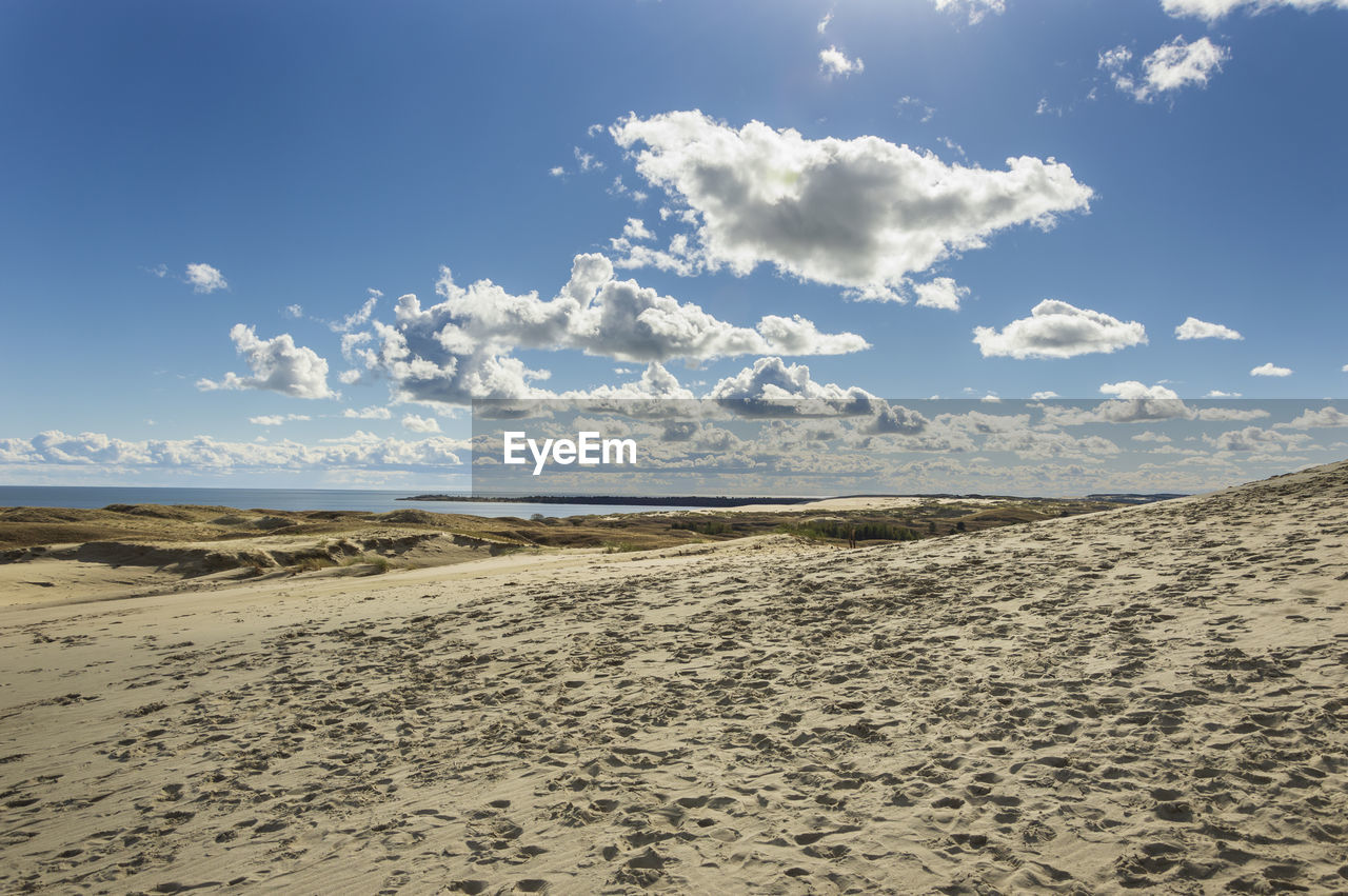 sky, land, sand, beach, scenics - nature, cloud - sky, beauty in nature, tranquility, tranquil scene, nature, sea, landscape, non-urban scene, environment, horizon, day, no people, remote, water, idyllic, outdoors, arid climate, climate, place