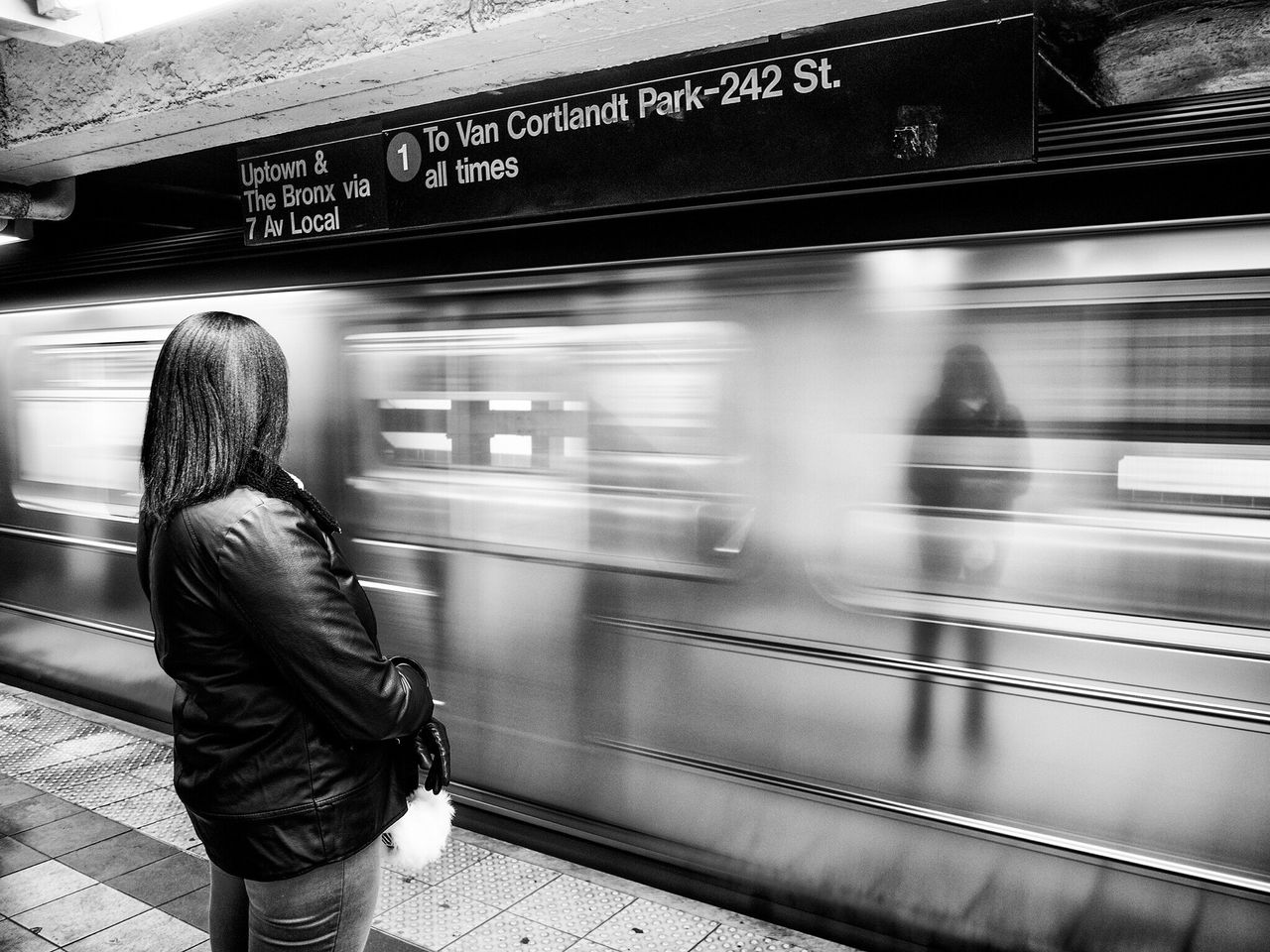 Woman Standing In Front Of Moving Subway Train At Platform