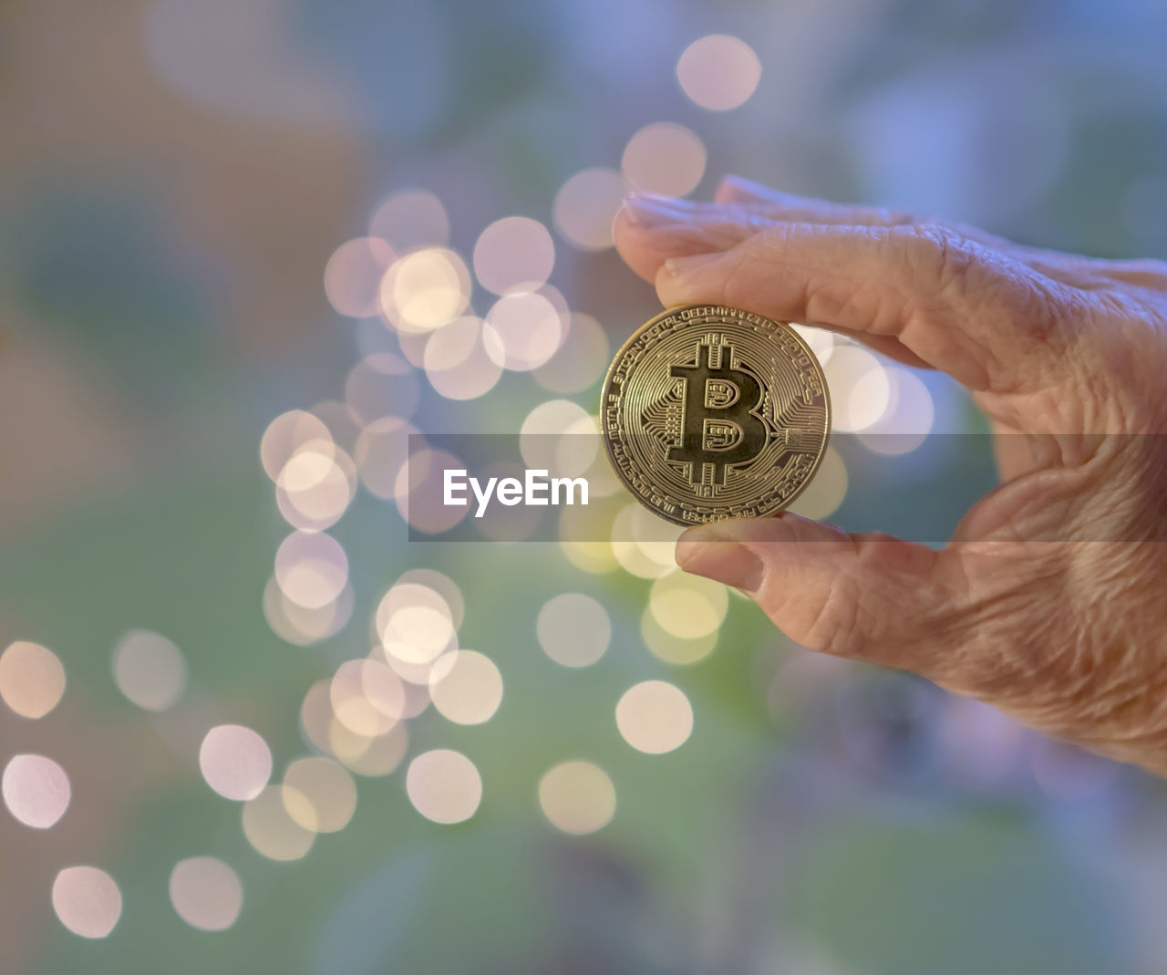 coin, human hand, one person, currency, finance, holding, human body part, savings, wealth, real people, focus on foreground, close-up, outdoors, day, people