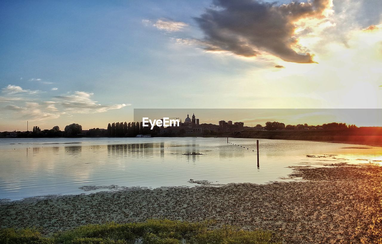 sky, architecture, water, built structure, building exterior, cloud - sky, sunset, city, no people, reflection, travel destinations, outdoors, waterfront, cityscape, nature, skyscraper, beauty in nature, tree, urban skyline, day