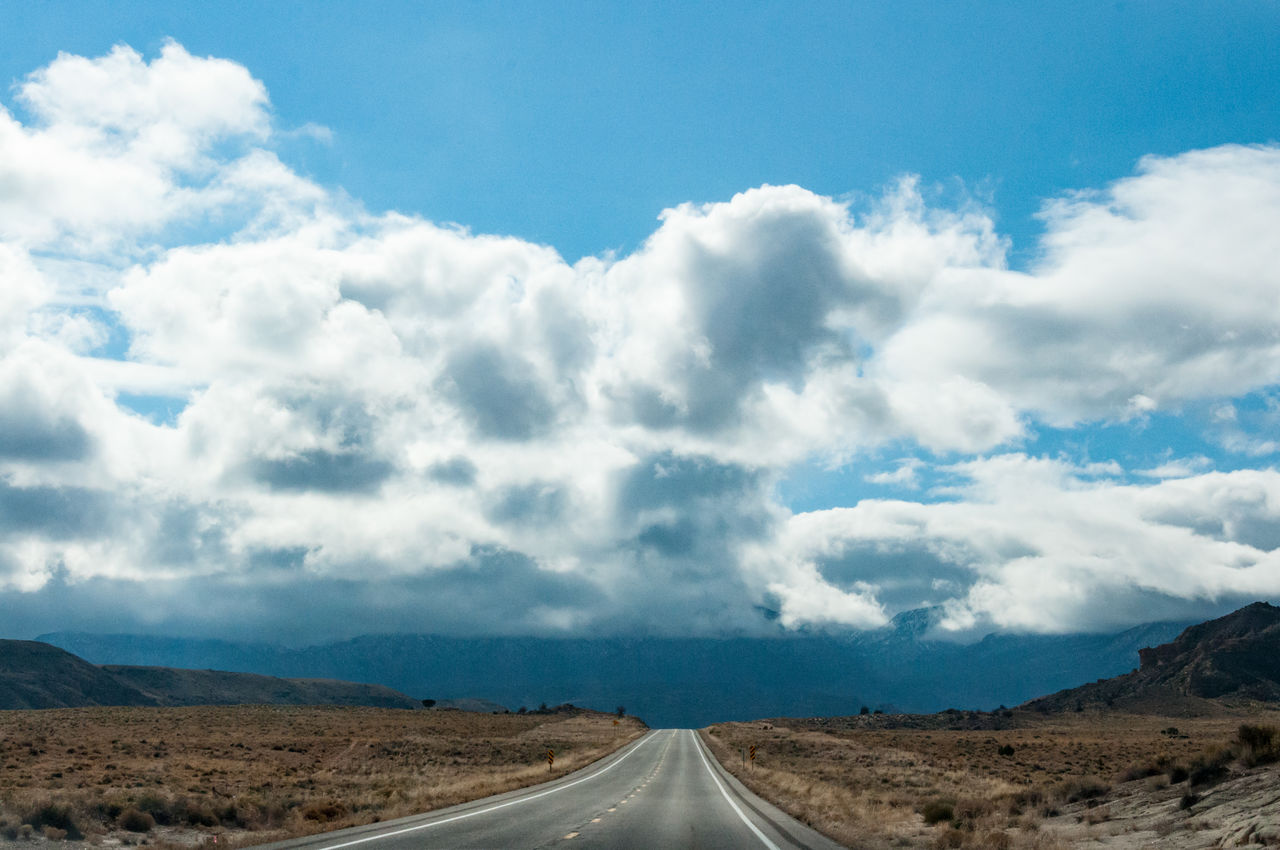 road, cloud - sky, transportation, the way forward, landscape, sky, day, scenics, nature, outdoors, tranquility, beauty in nature, tranquil scene, no people, winding road
