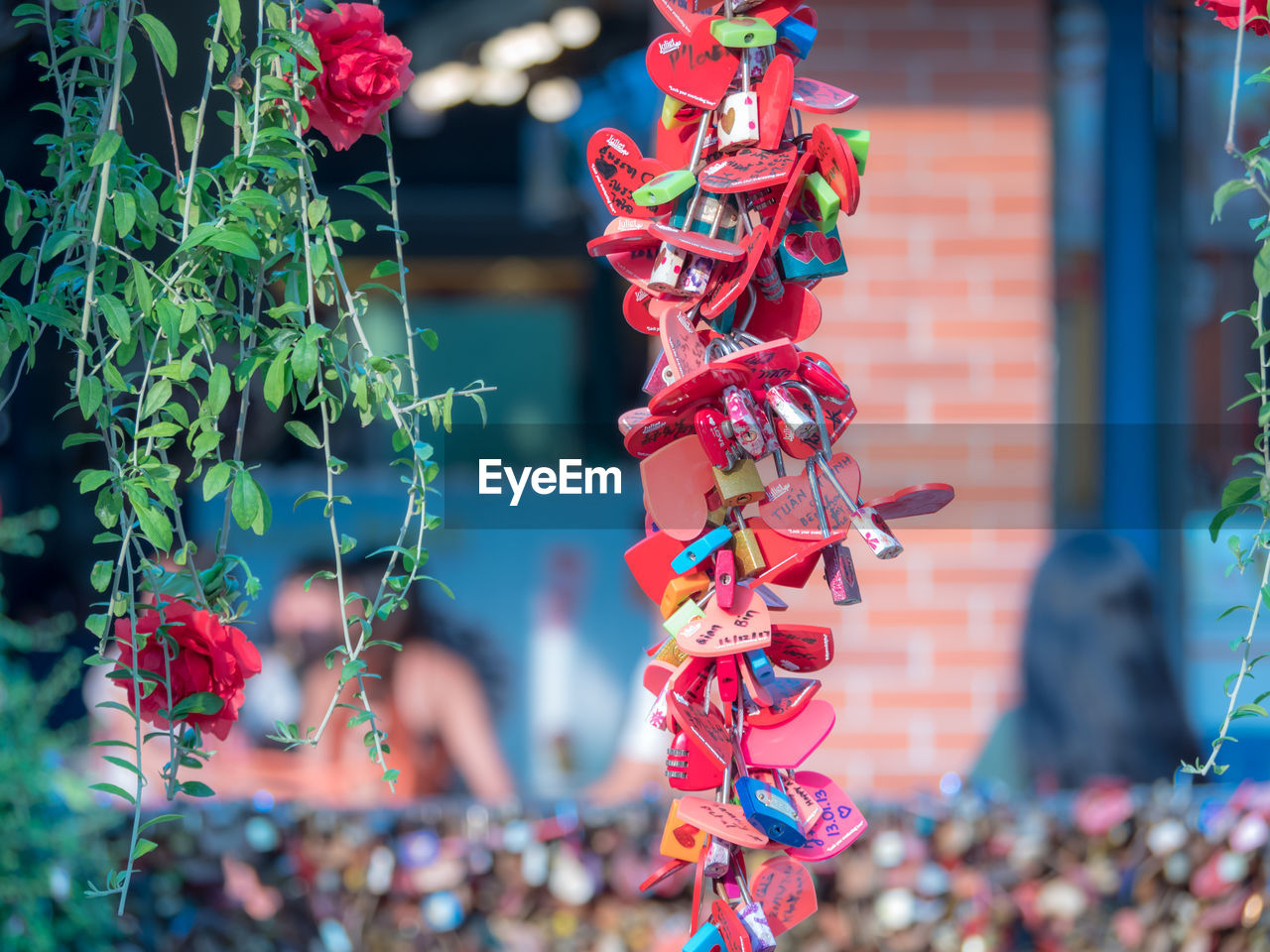 no people, representation, day, focus on foreground, decoration, creativity, art and craft, red, close-up, selective focus, outdoors, multi colored, hanging, nature, plant, celebration, for sale, toy, human representation, festival