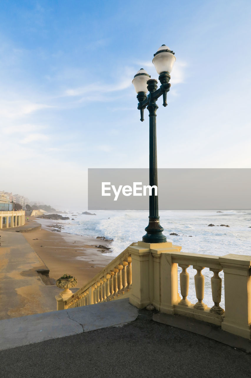 water, sky, sea, nature, lighting equipment, street light, street, no people, built structure, scenics - nature, architecture, day, railing, beauty in nature, horizon, land, cloud - sky, beach, horizon over water, outdoors, balustrade