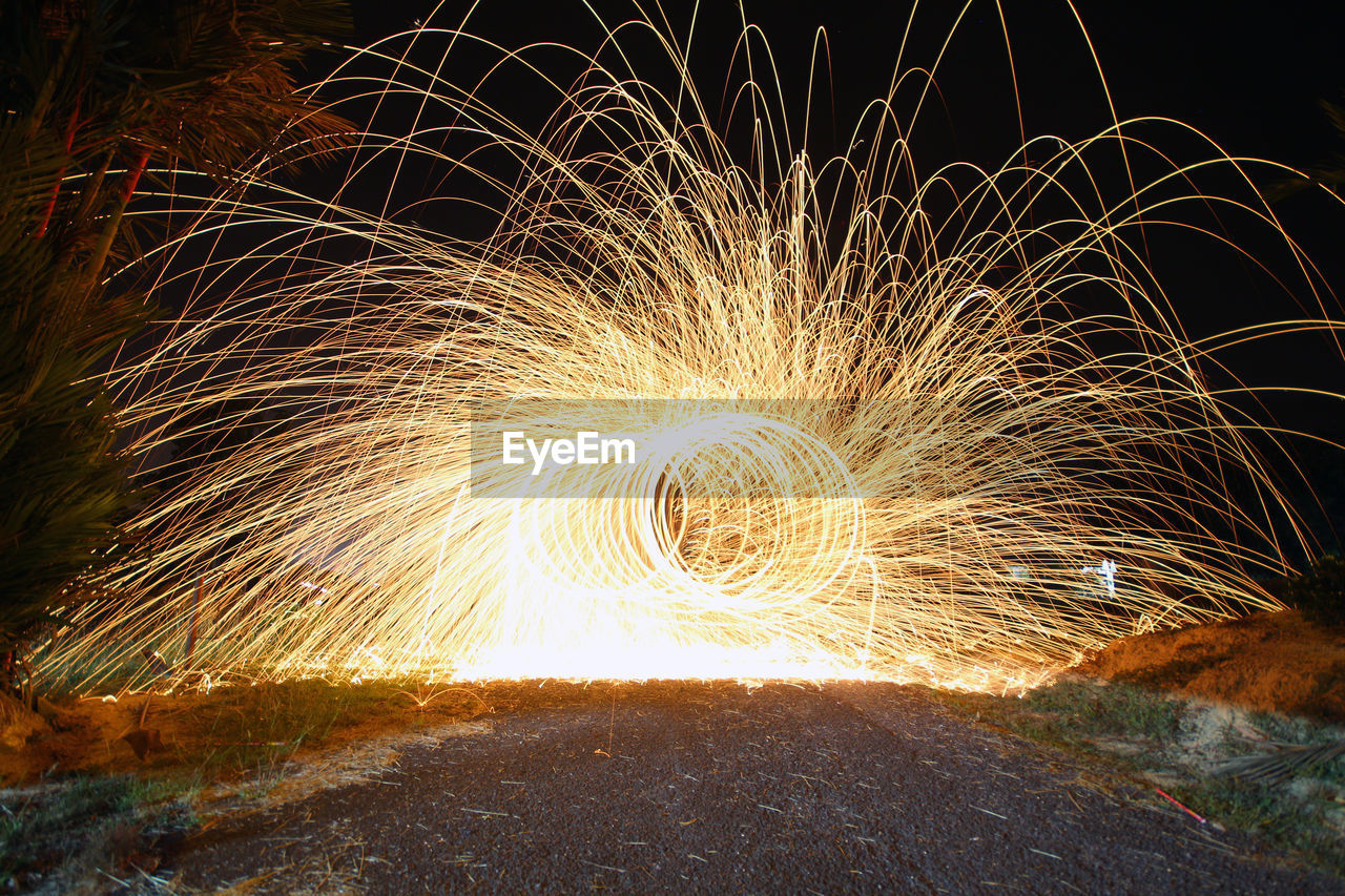View Of Spinning Wire Wool Against Sky At Night