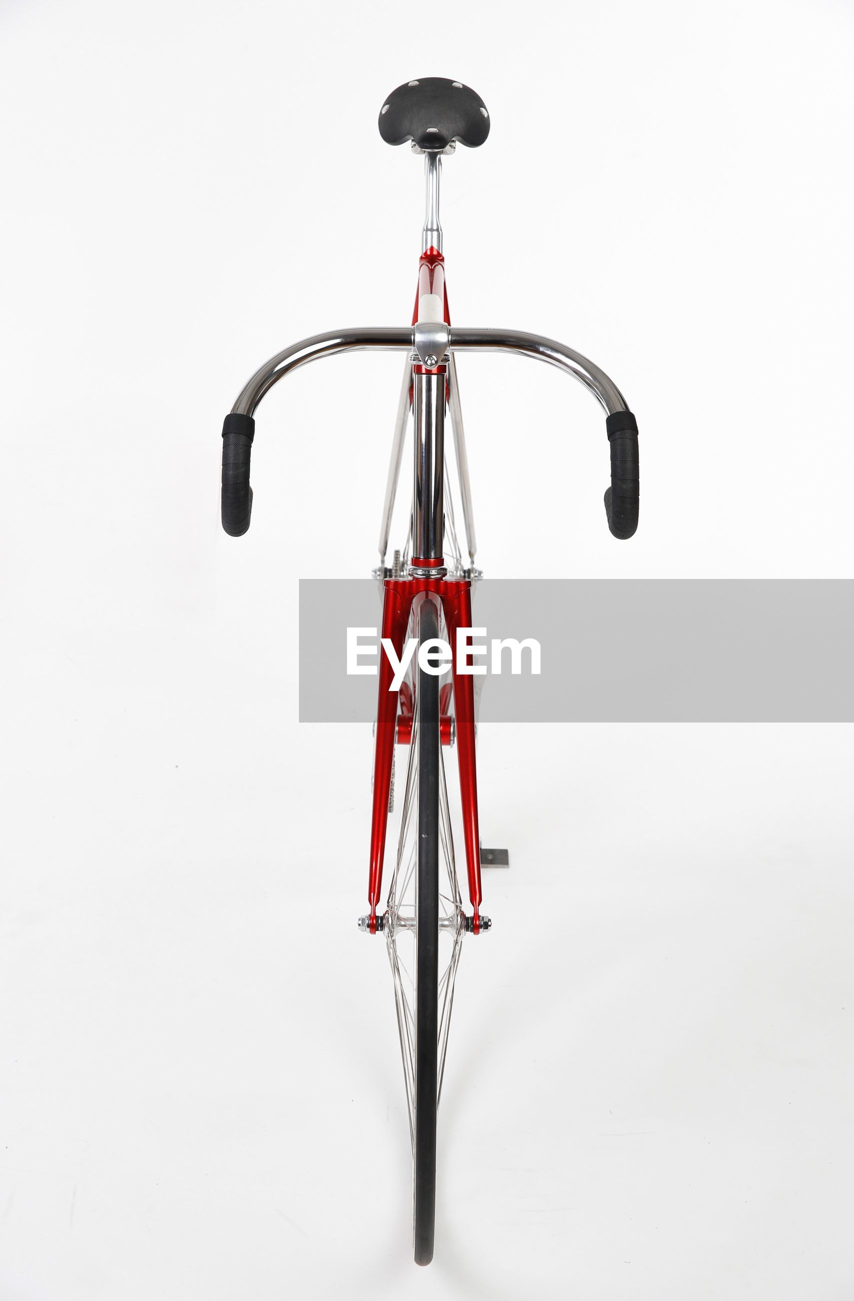 Close-up of red bicycle against white background