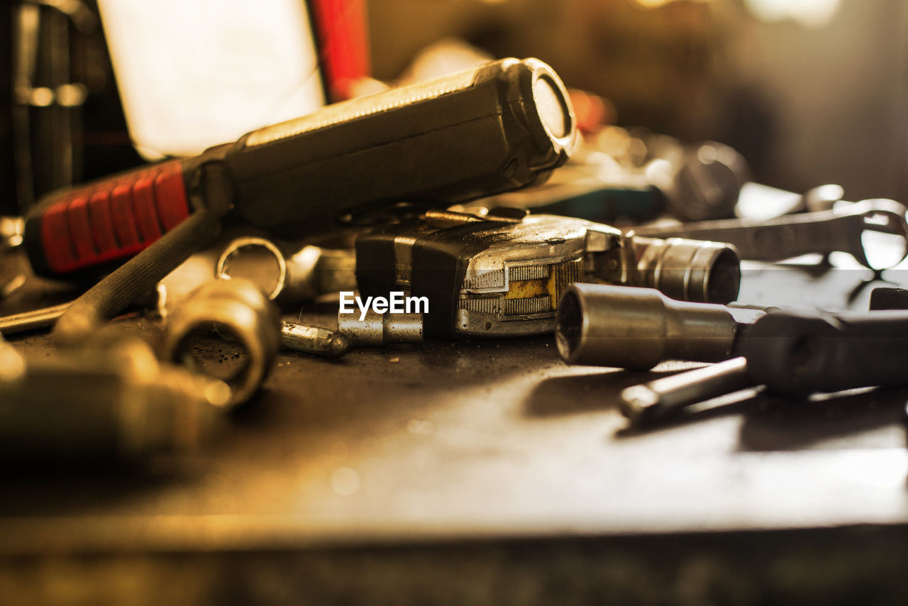selective focus, close-up, metal, indoors, no people, table, still life, connection, technology, nut - fastener, communication, weapon, equipment, cable, focus on foreground, work tool, day, screw, group of objects, tool
