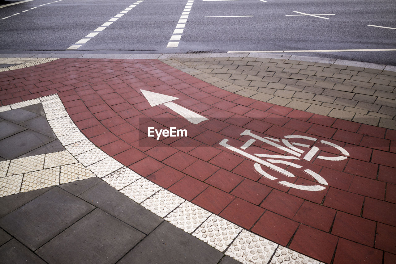 High angle view of arrow symbol with bicycle lane on road
