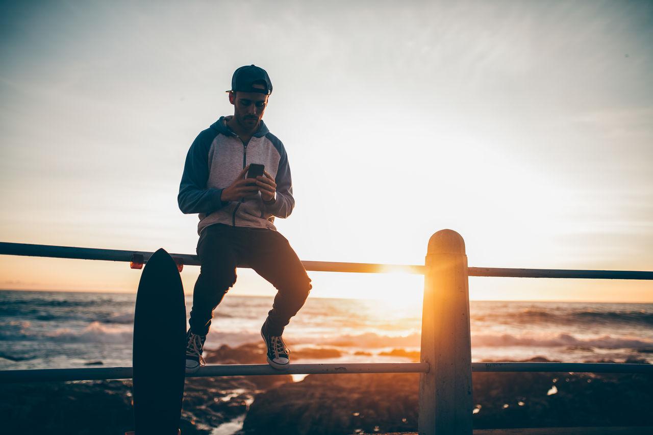 Man Sitting On Beach