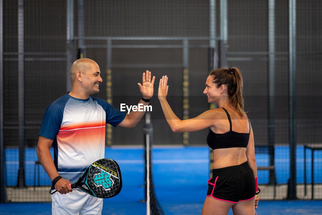 Portrait of handshake of two padel tennis players