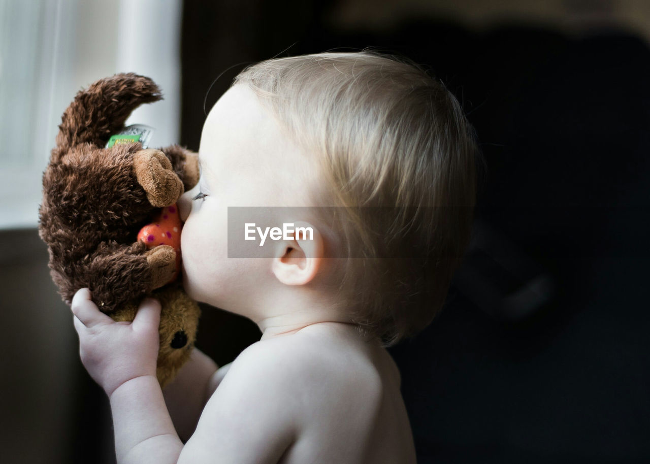 Close-Up Of Cute Baby With Stuffed Toy