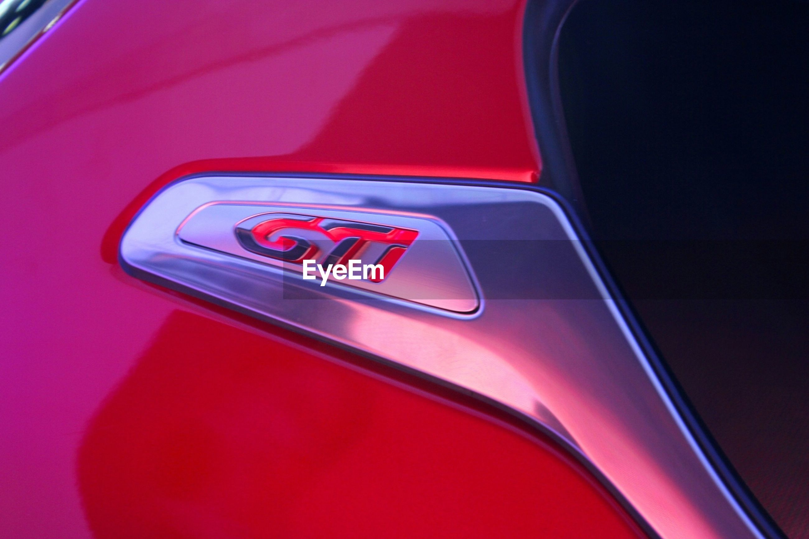 transportation, red, car, mode of transport, land vehicle, close-up, vehicle interior, communication, indoors, part of, no people, travel, technology, text, car interior, speed, dashboard, high angle view, road, on the move