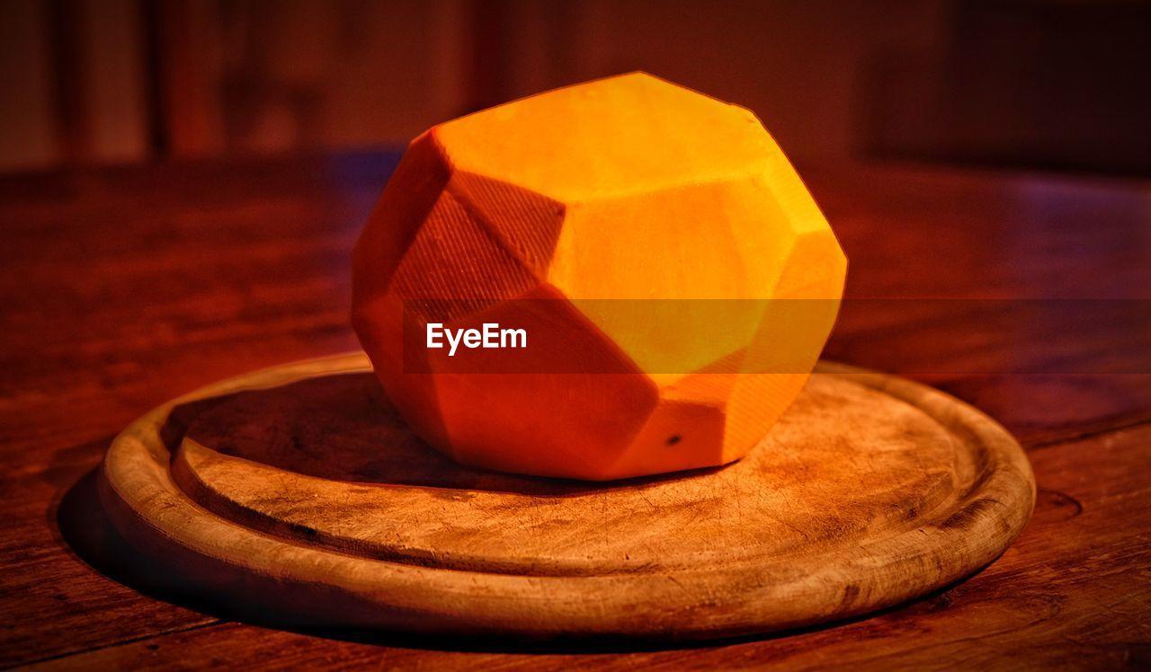 Hexagon shaped pumpkin on cutting board