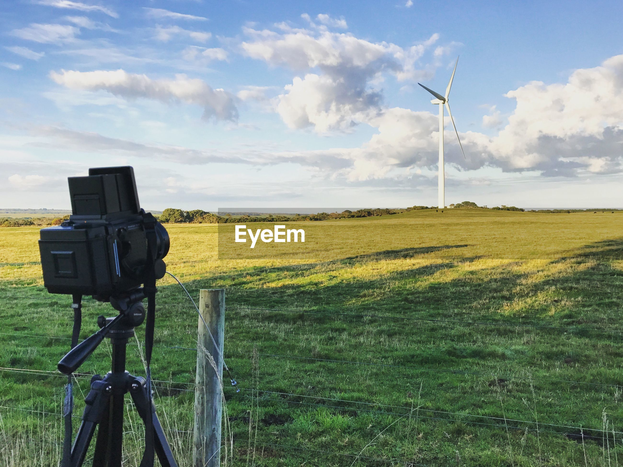alternative energy, wind power, technology, field, wind turbine, fuel and power generation, renewable energy, windmill, environmental conservation, grass, sky, landscape, cloud - sky, nature, no people, day, rural scene, beauty in nature, green color, traditional windmill, outdoors, scenics, photography themes, industrial windmill, tree