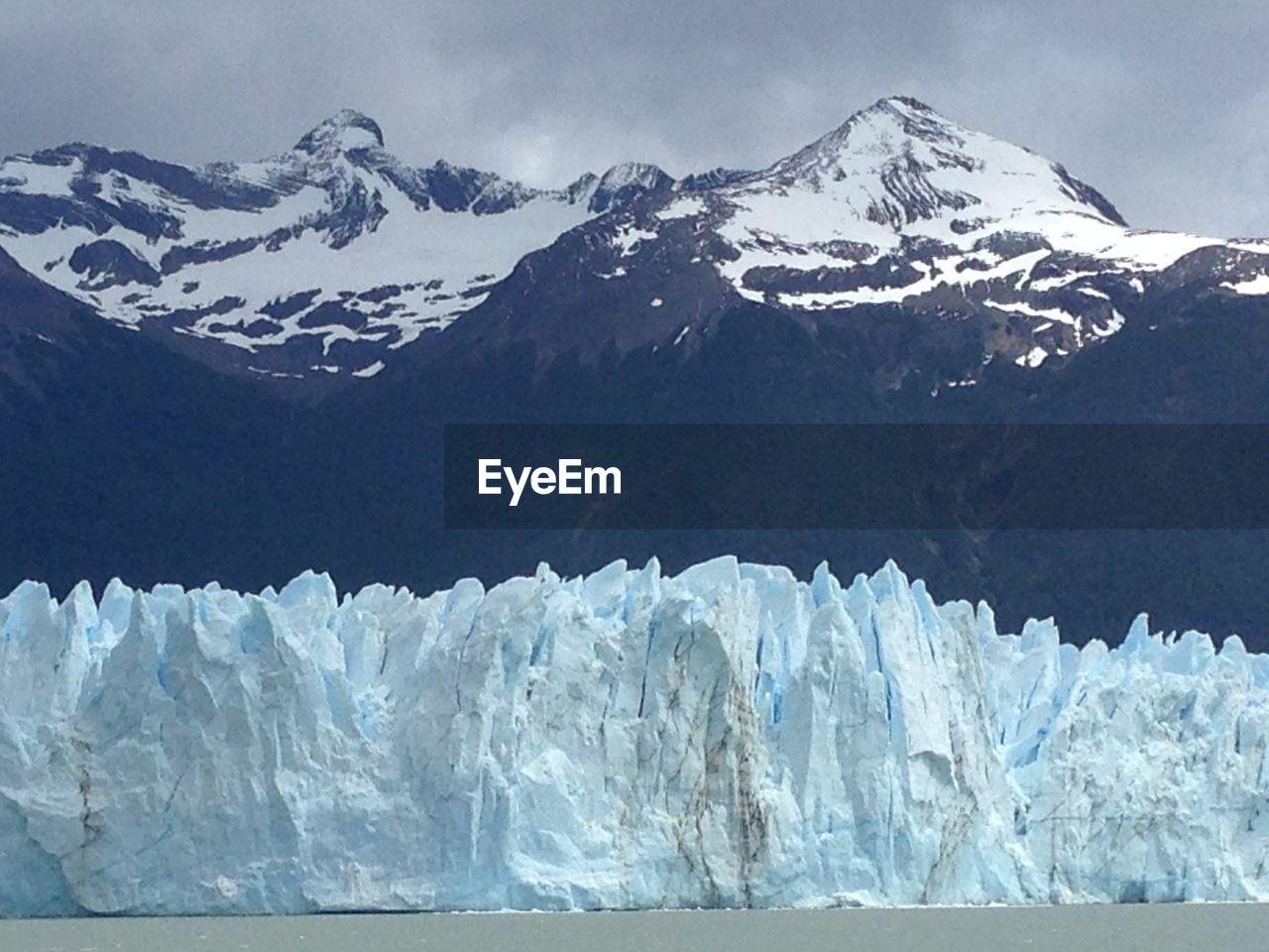 Snowed landscape against mountain range