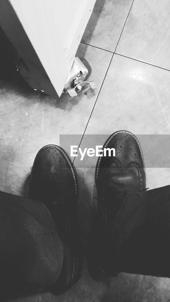 low section, human leg, shoe, human foot, tiled floor, high angle view, human body part, real people, standing, indoors, men, day, close-up, people