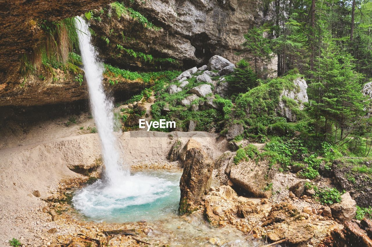 Water Falling Through Rocks In Forest