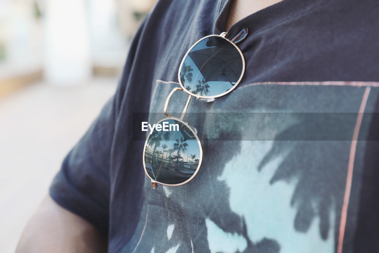 Midsection of man with sunglasses