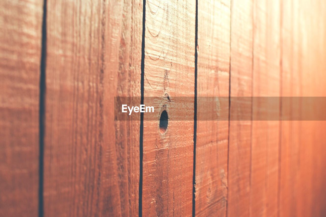 wood - material, full frame, brown, textured, no people, backgrounds, pattern, close-up, day, wood, selective focus, plank, outdoors, sunlight, rough, nature, barrier, boundary, cracked, wall - building feature, wood grain