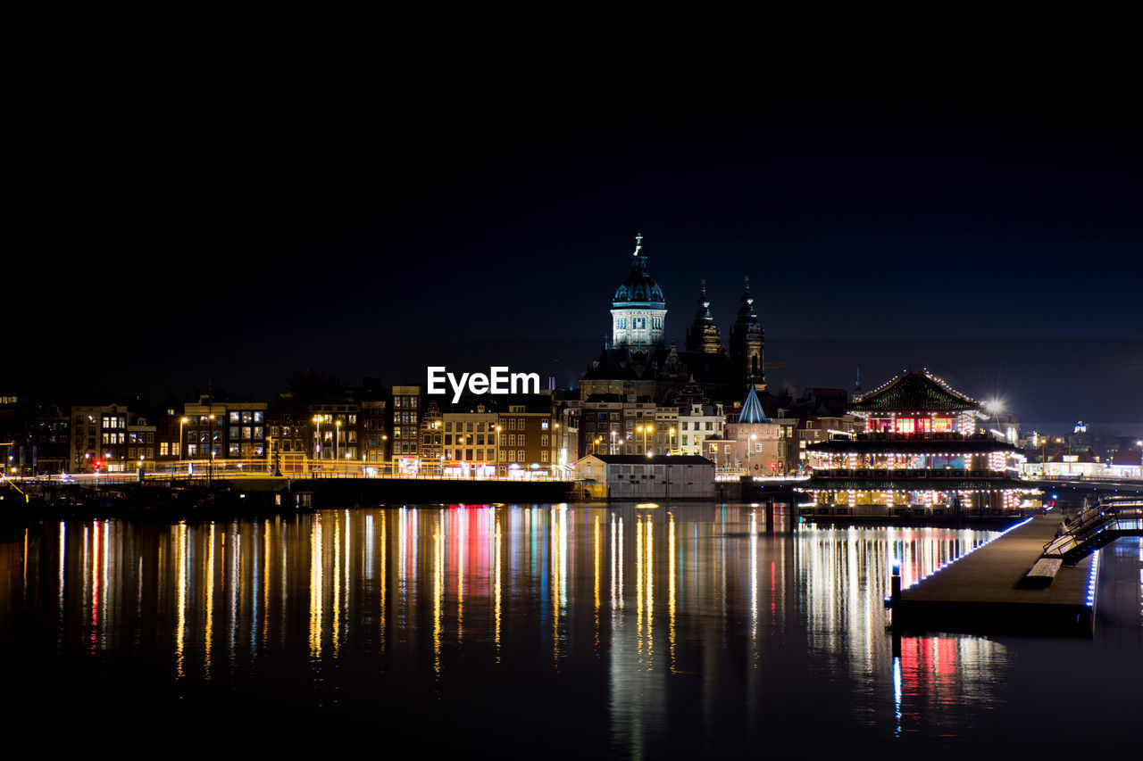 building exterior, illuminated, architecture, built structure, night, water, sky, reflection, building, waterfront, city, no people, copy space, nature, river, travel destinations, clear sky, nautical vessel, outdoors