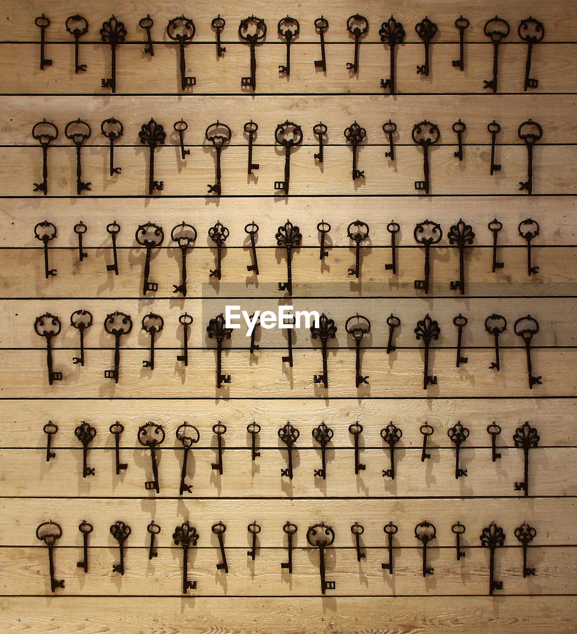 in a row, large group of objects, communication, shelf, front view, arrangement, old-fashioned, no people, indoors, optometrist, day