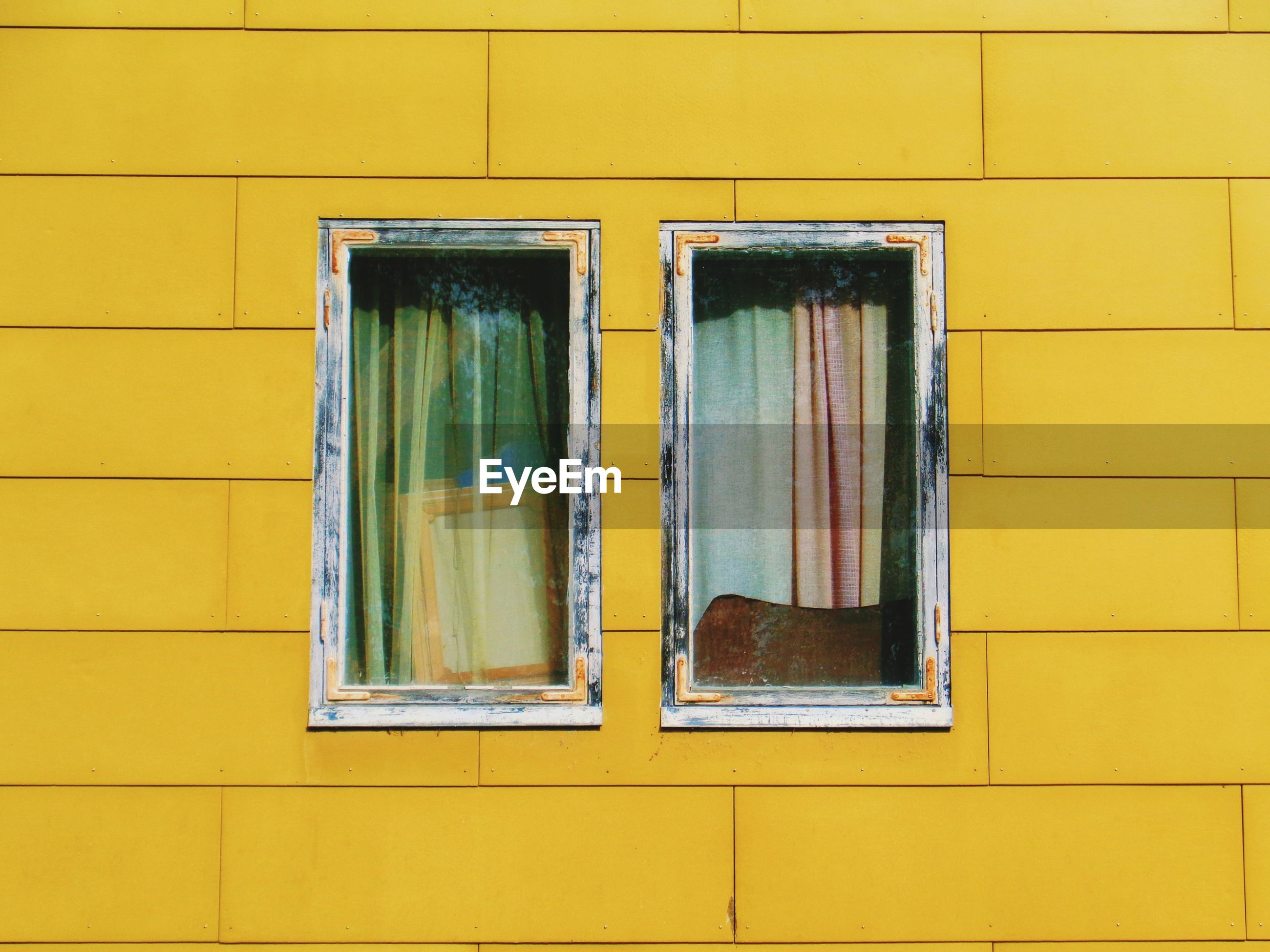 Full frame shot of yellow window of building