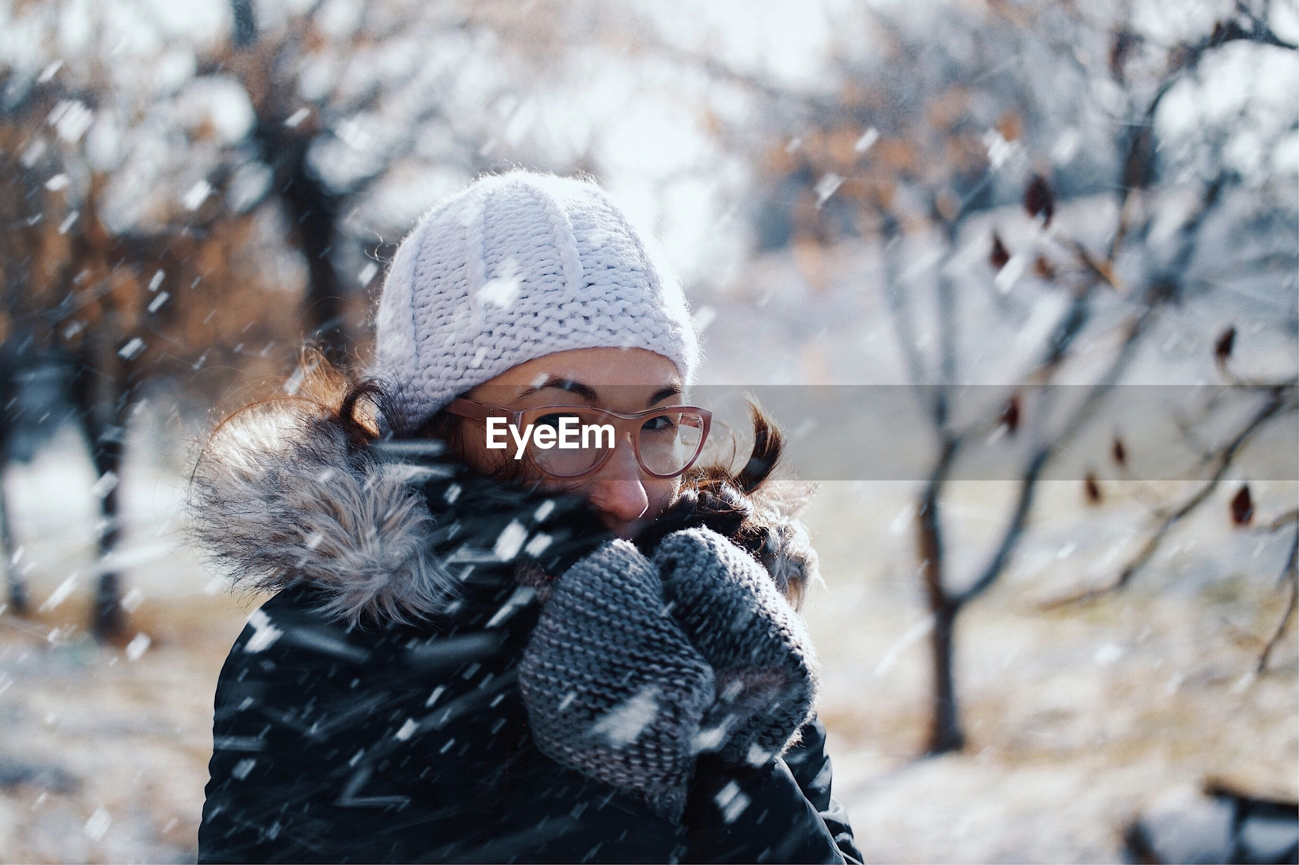 Portrait of mid adult woman during snowfall