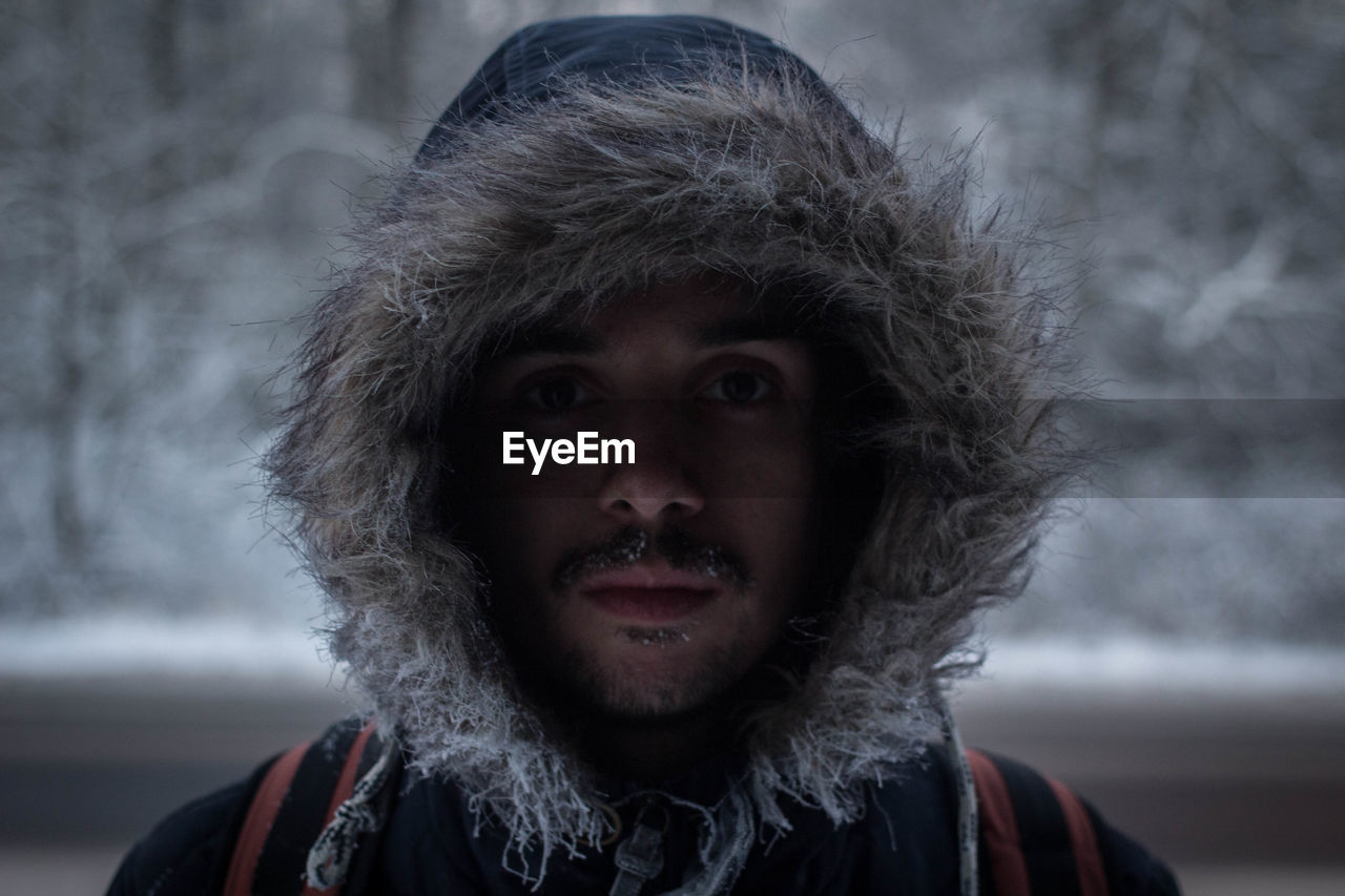 Portrait Of Man Wearing Hood During Winter