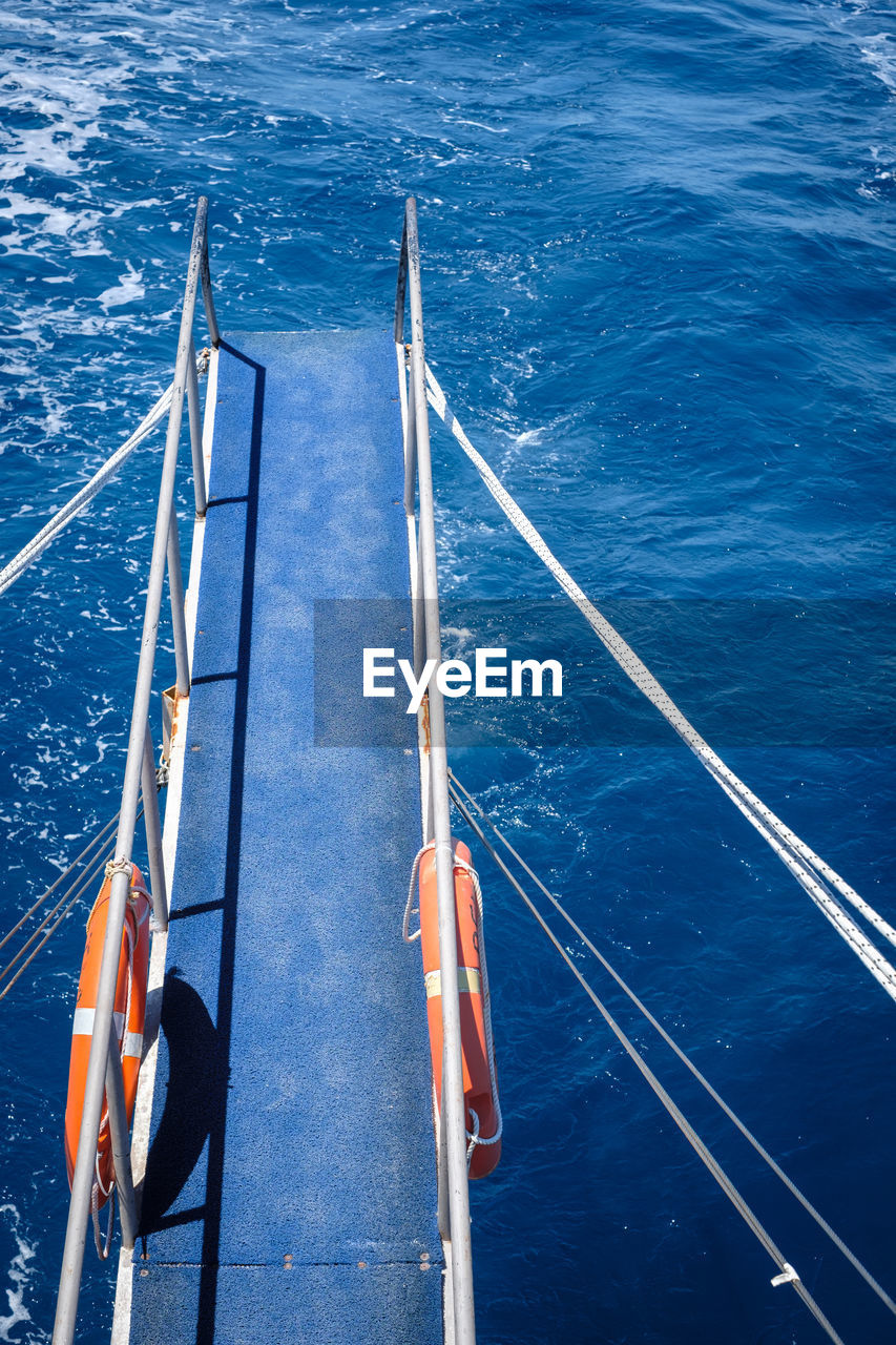 high angle view, sea, water, nautical vessel, transportation, day, blue, outdoors, sailing, nature, no people, boat deck