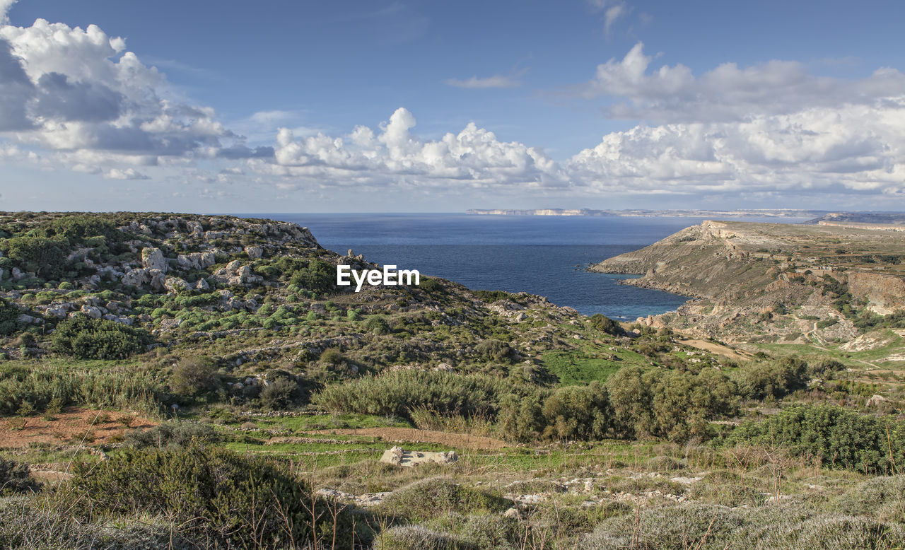 Scenic View Of Sea And Landscape Against Sky