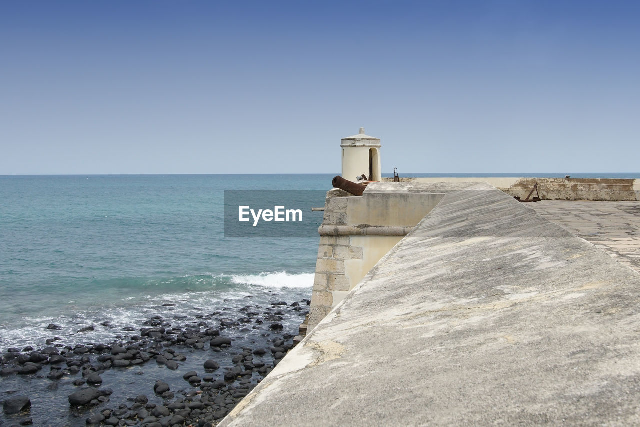 sea, horizon over water, water, clear sky, scenics, day, nature, copy space, outdoors, tranquil scene, tranquility, no people, built structure, beauty in nature, architecture, blue, sky, building exterior, lighthouse