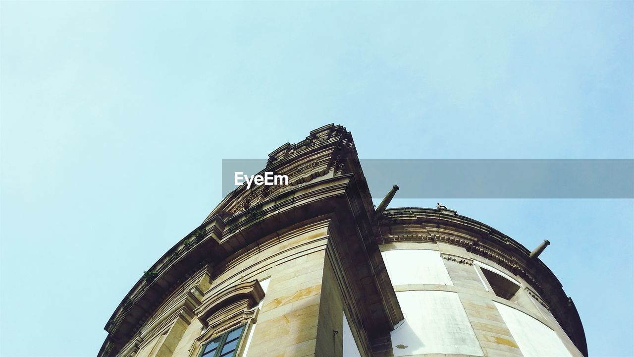 low angle view, architecture, built structure, building exterior, copy space, religion, history, day, no people, spirituality, outdoors, place of worship, clear sky, sky